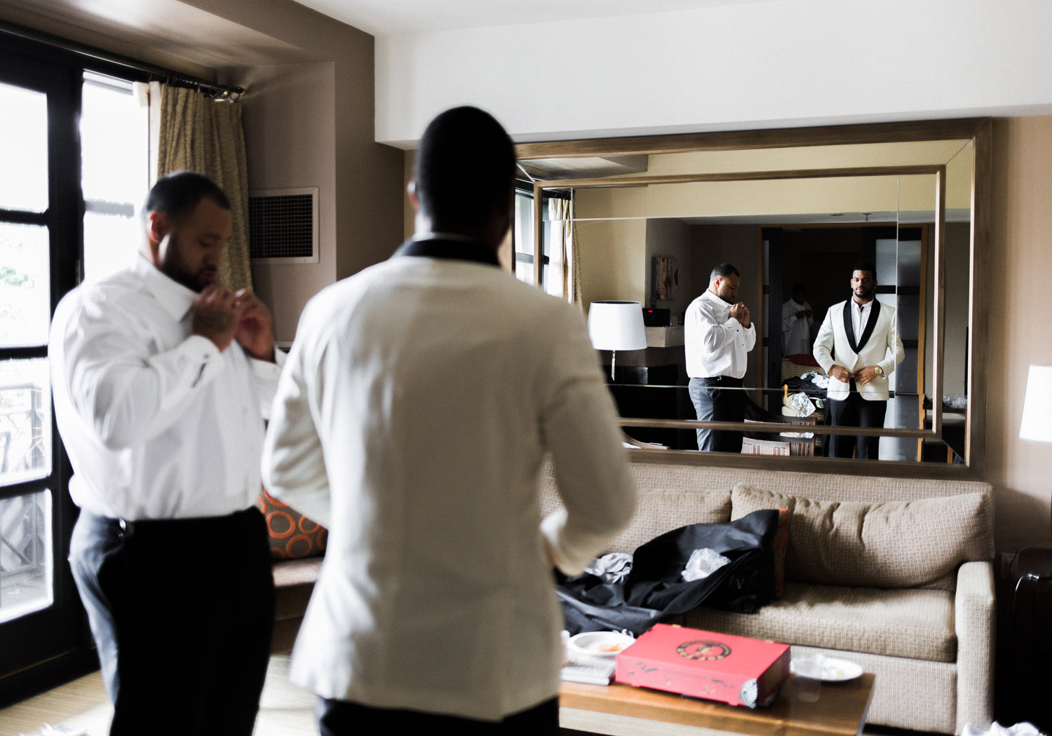 groom in cream jacket getting ready.jpg