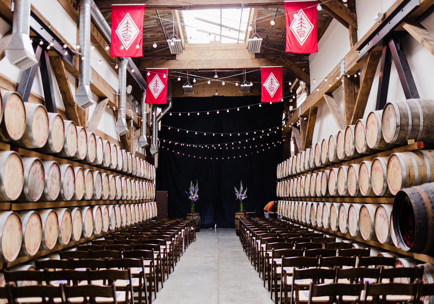 Westland Distillery Indoor Ceremony Venue Space In the Barrel Room by Alexandra Knight Photography Seattle Wedding Photographer