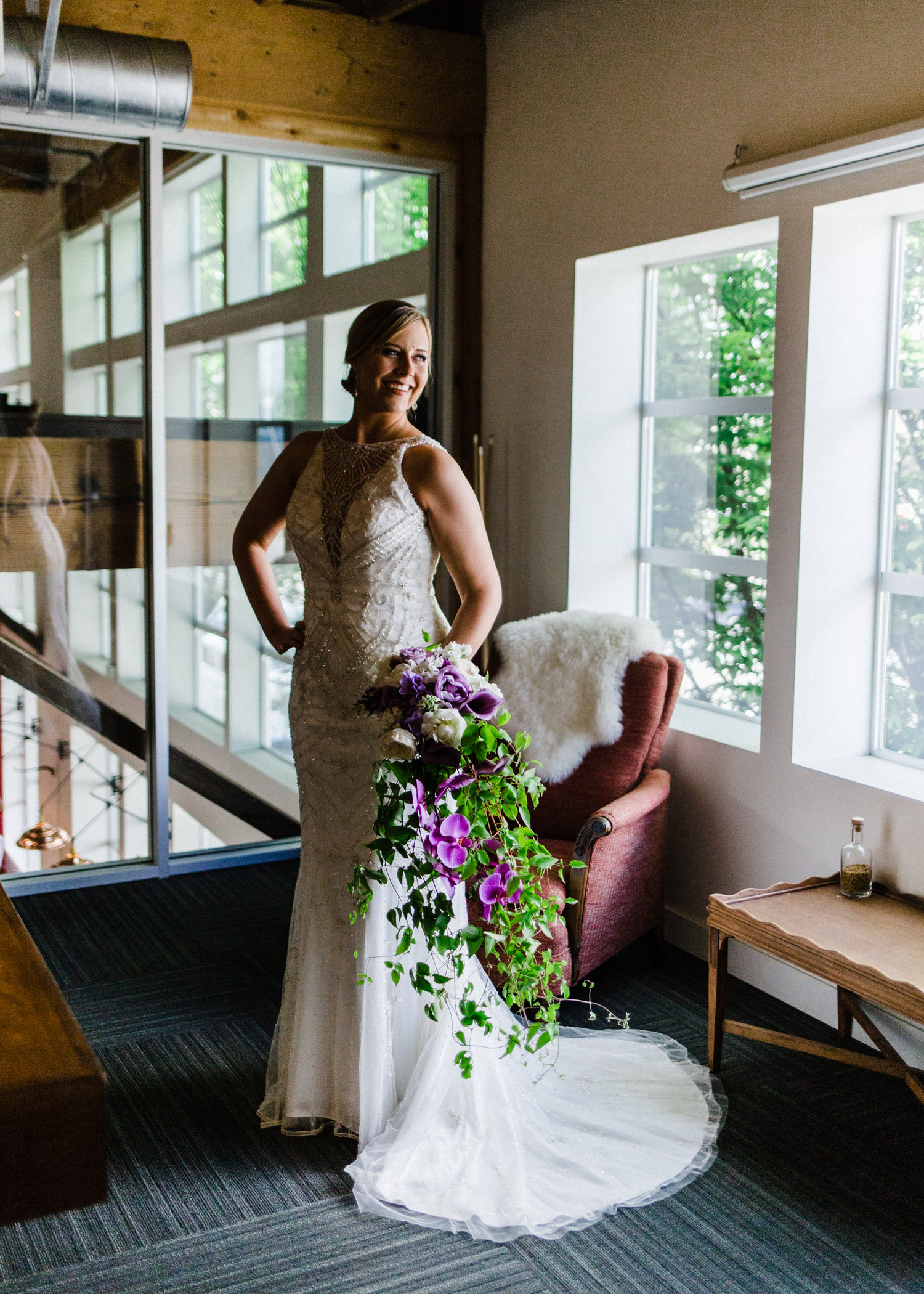 Bride with Cascading Flower Bouquet at Westland Distillery by Alexandra Knight Photography Seattle Wedding Photographer