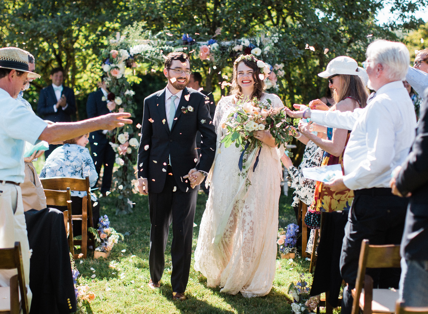 Seattle bride and groom wedding ceremony recessional with a petal toss