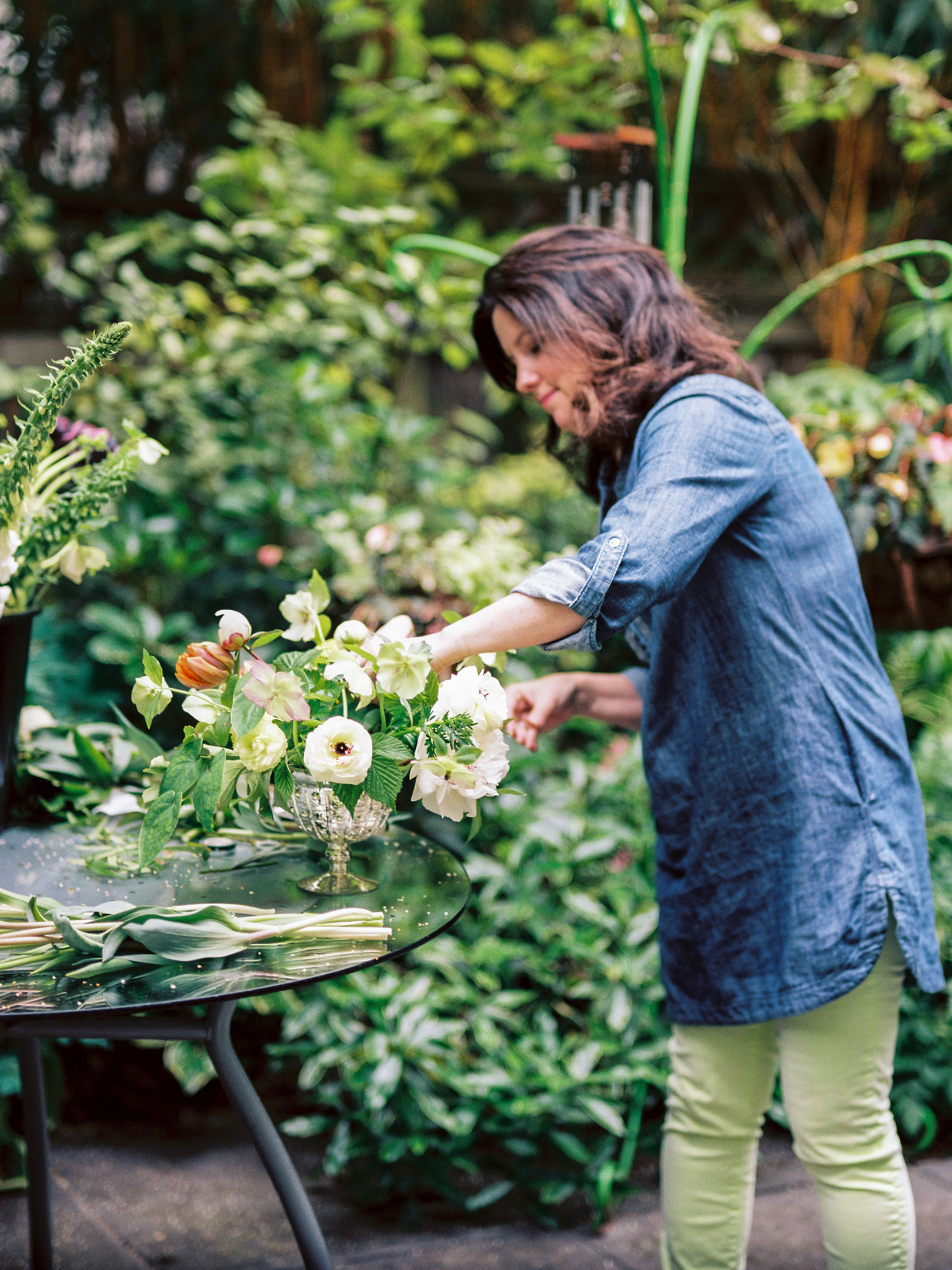 seattle florist smashing petals working on custom wedding flowers.jpg
