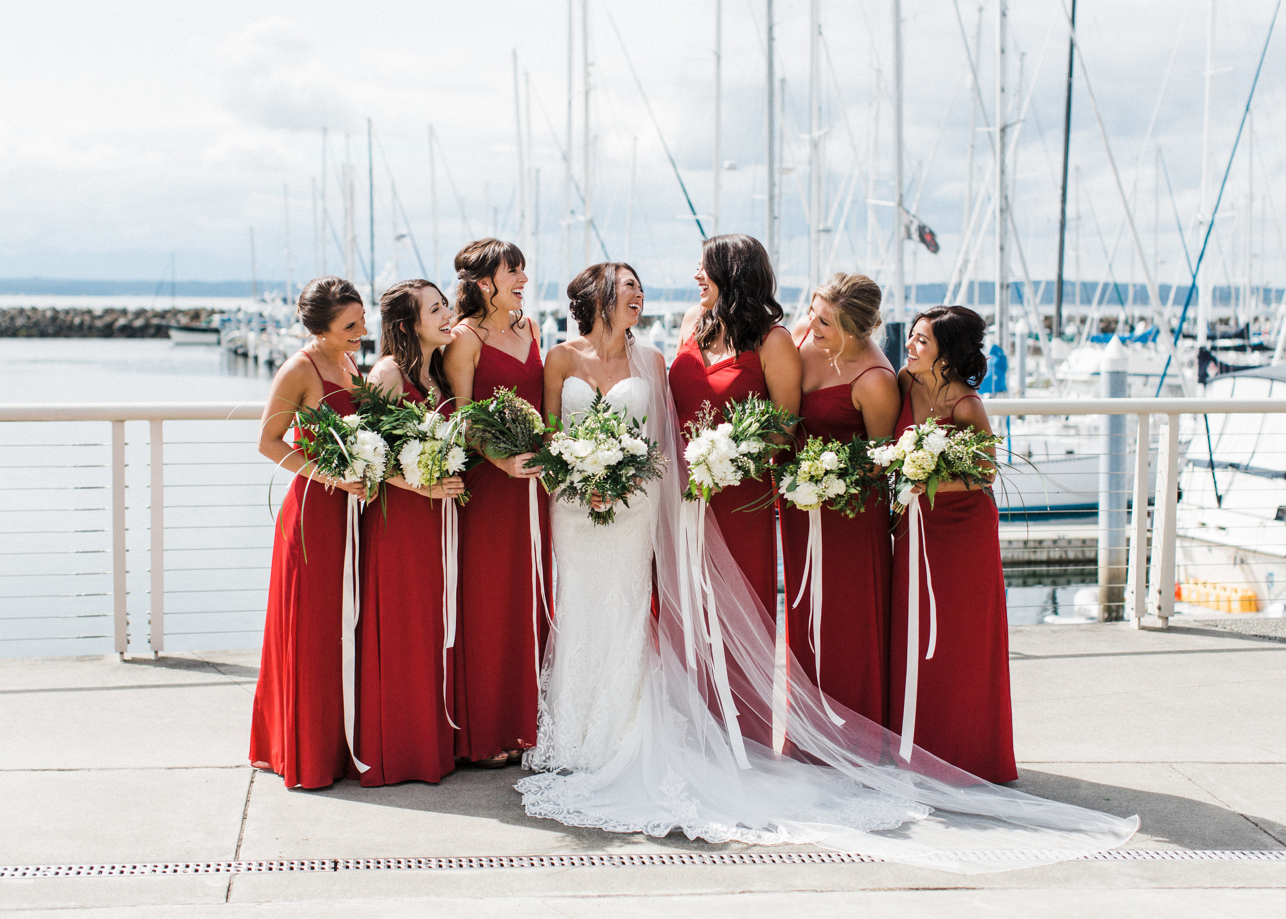 Bride and bridesmaids at shilshole bay marina in ballard Seattle Alexandra Knight Photography