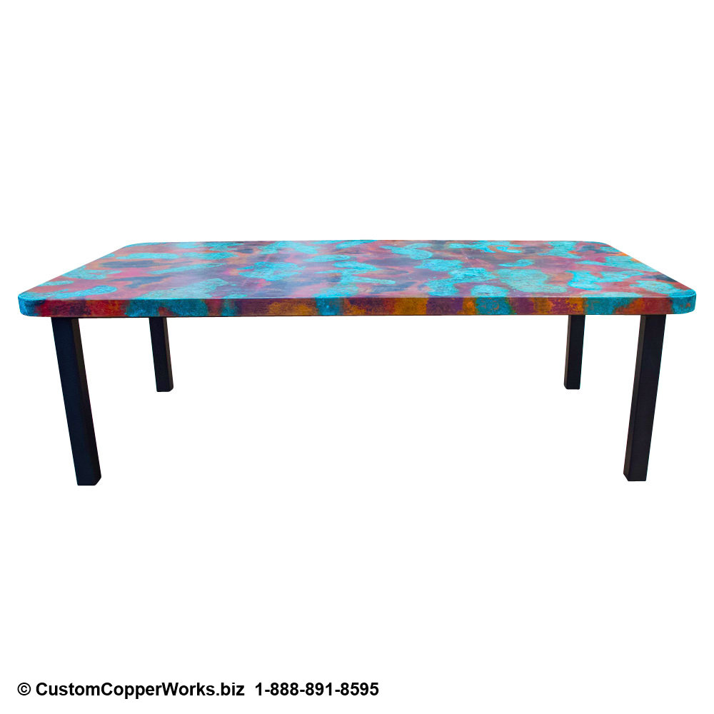 Hand-hammered rectangle copper top dining table mounted on black powder coated, modern, forged-iron table base.