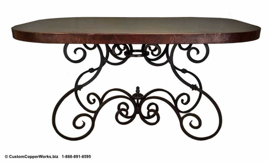 OVAL, COPPER TOP DINING TABLE: Copper Table Top mounted on a modified version of the  Canela  forged-iron table base.