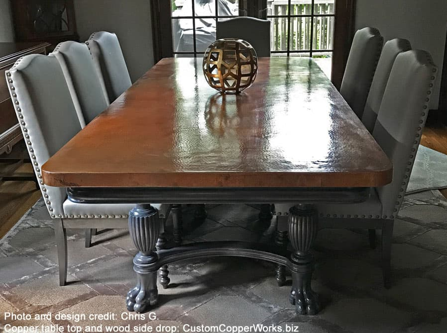 """Copper top dining table — 102"""" x 46"""" — mounted on reworked traditional, antique wood trestle table base. Finish is a white glazed ebony."""