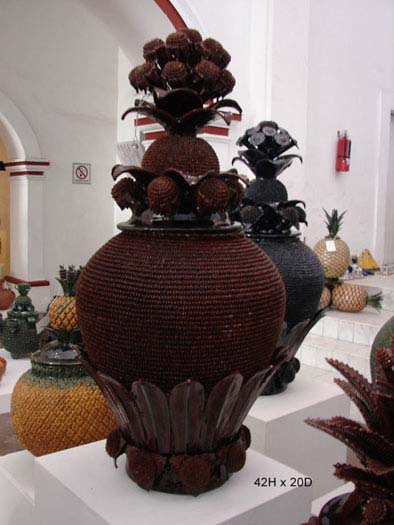 Pedro Hernandez Carlos and his family specialize in the famous Mexican ceramic pineapple pottery art of San Jose de Gracia, Michoacan.    Pineapple (piña) art originally began as a tribute to the pine tree. The word  pino  in Spanish means pine tree. Over time  pino  became  piña  meaning pineapple.