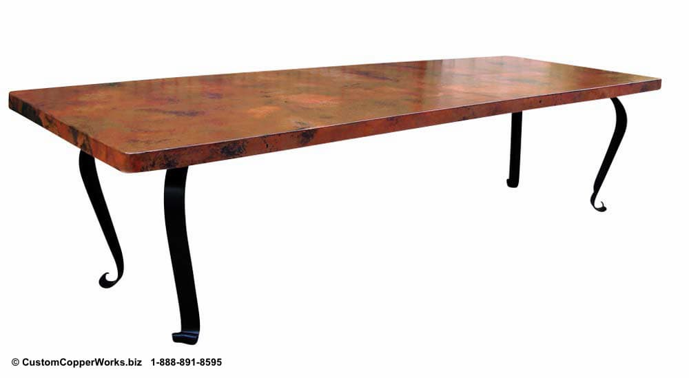 Copper top dining table mounted on the Lorena rectangle forged-iron table base.