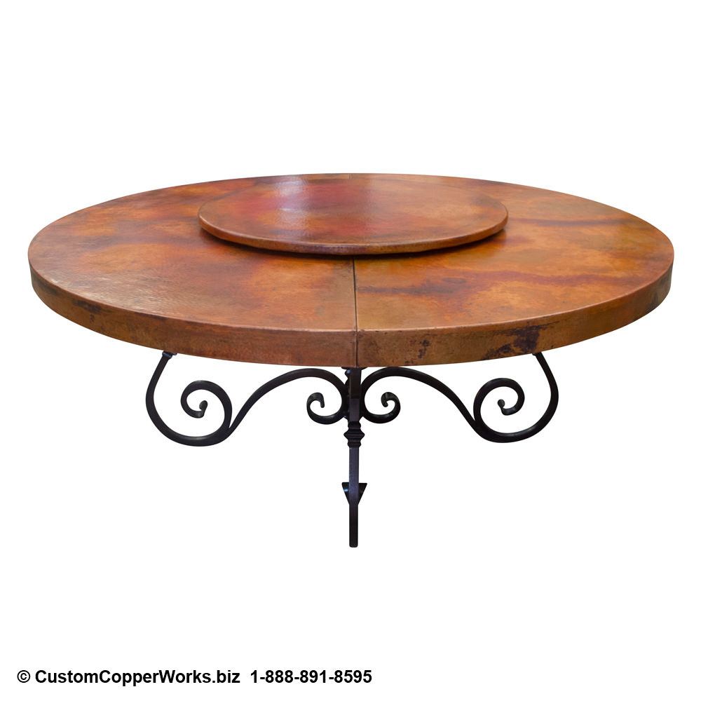Round copper top extension table; scrolled, Tucsan, Spanish Colonial style forged iron table base.