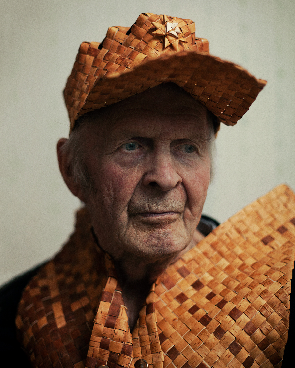 Portrait of an Old Man Wearing Tuohi,  2018.  Text