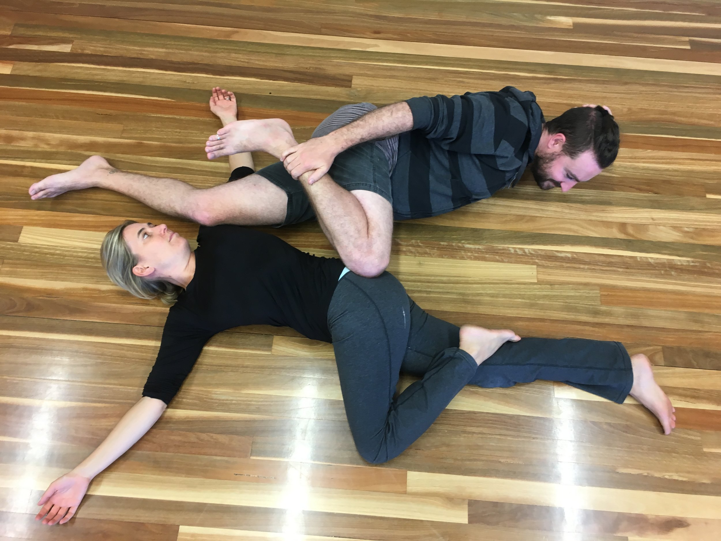 Dan helping Anna stretch without using his hands. His solution of using legs as contact points was effective in this stretch.