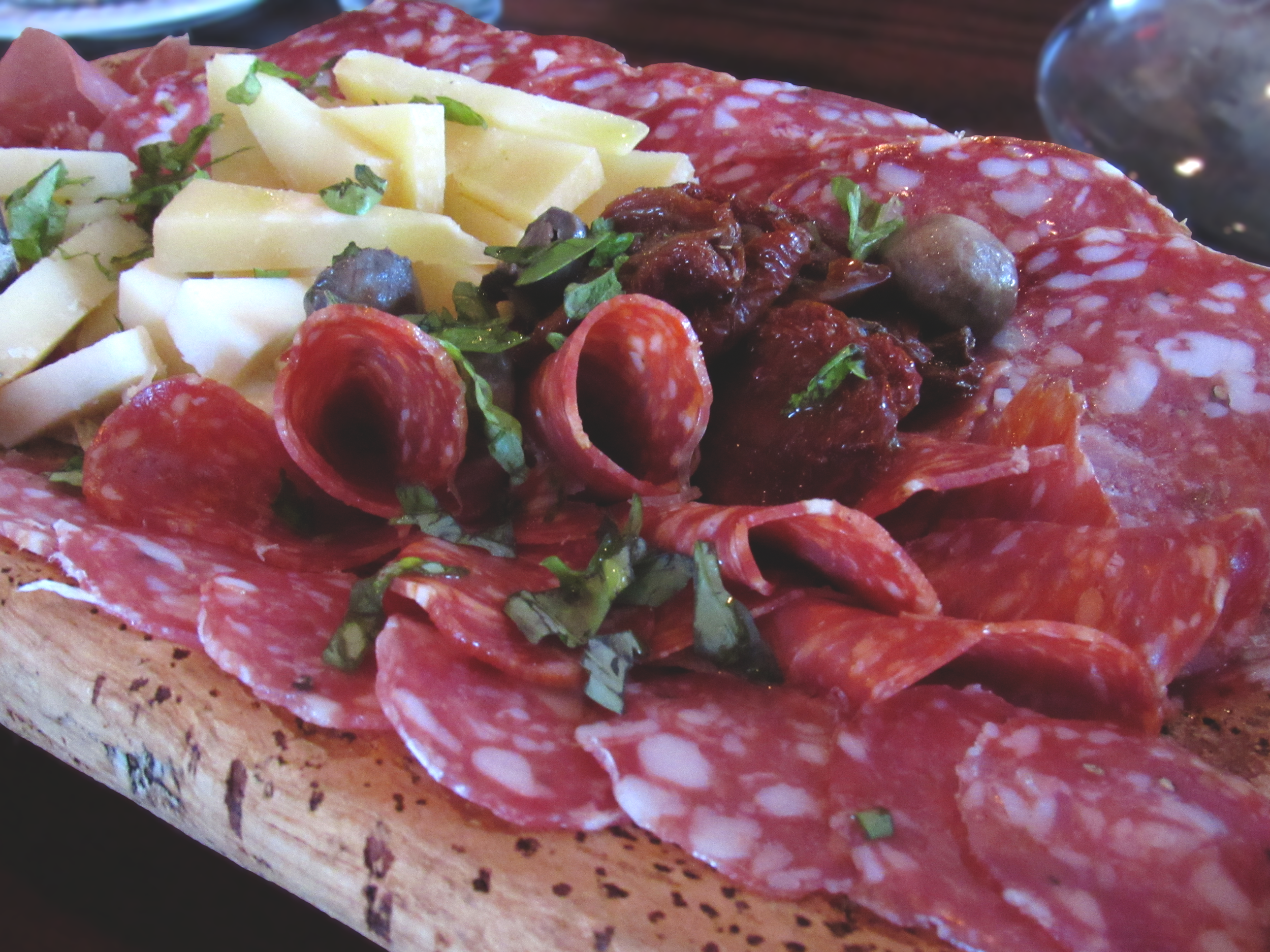Our First course, Salumeria, was a beautiful assortment of fine italian meats, cheeses, fresh homegrown basil, olives and sundried tomatos layered atop  Sardinian Pane Carasau .