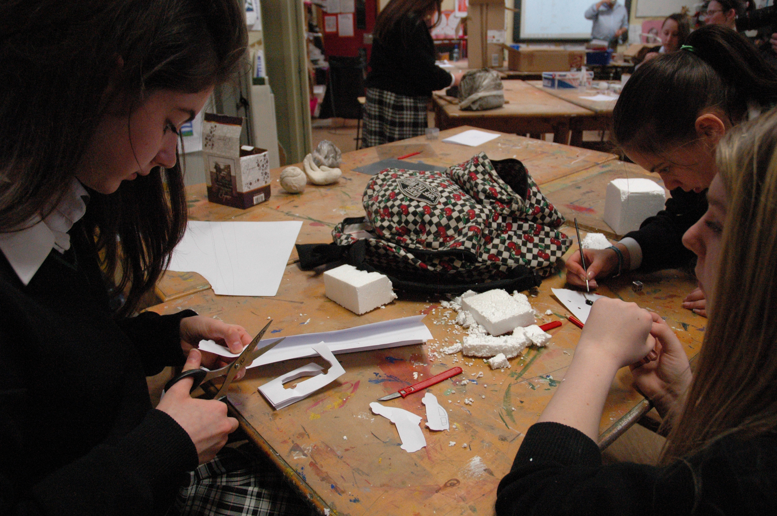 Students in early stages of creating an 'all-seeing eye' for a traffic roundabout.