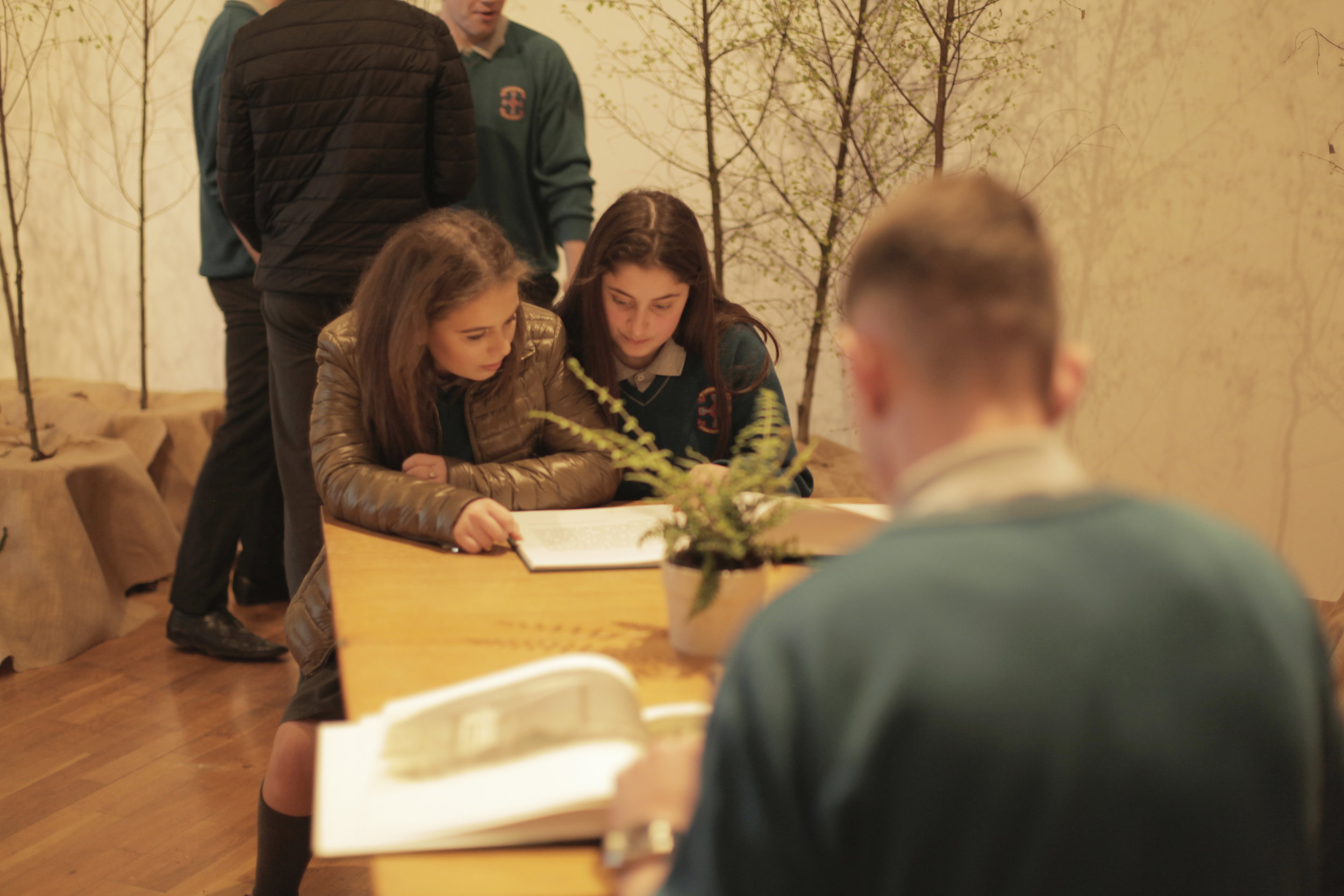 Students looking at artwork created by artist Jane Locke detailing research on the history of the postal system; at Futures exhibition 2017 at RHA Gallery, Dublin