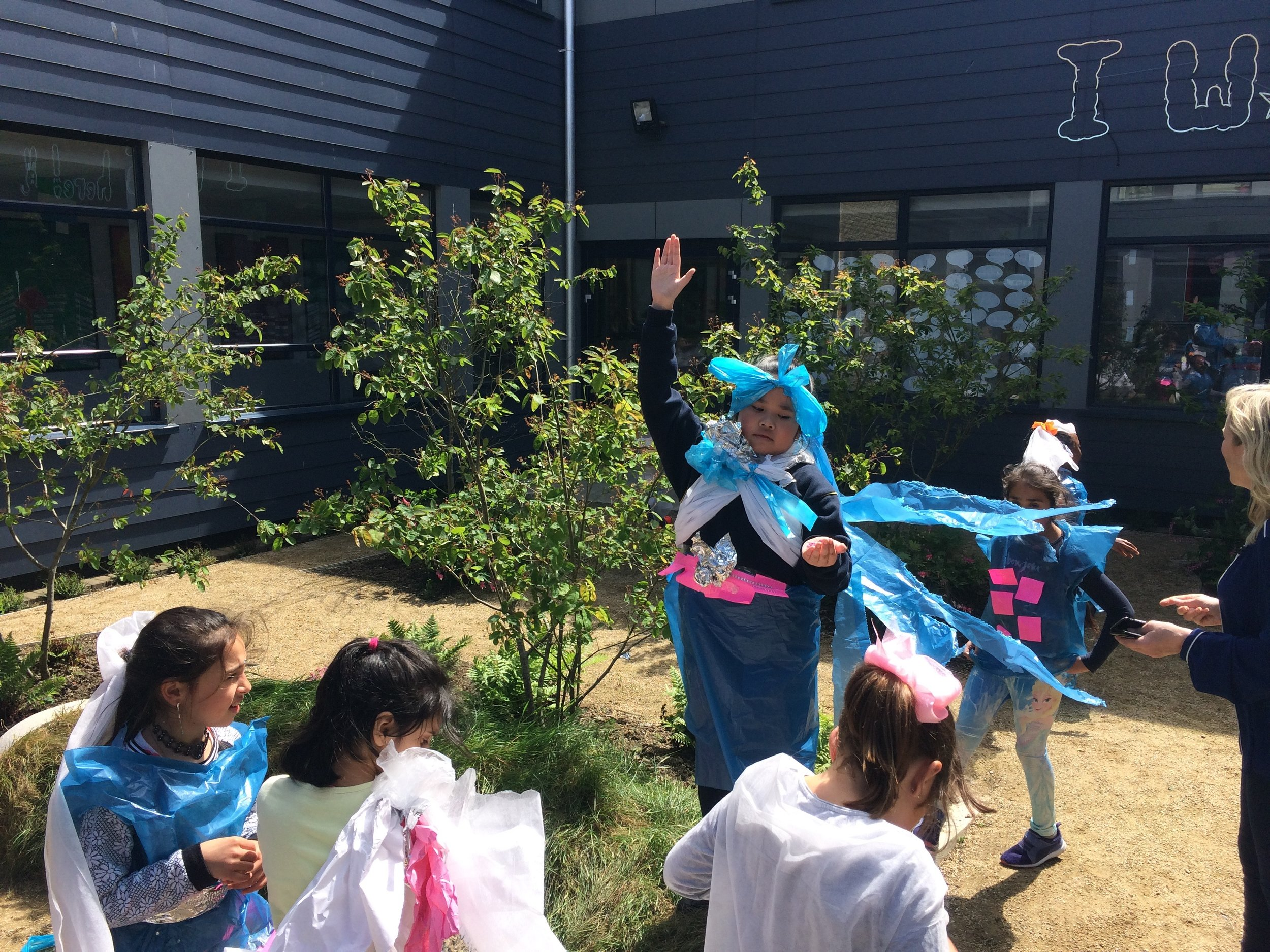 In one class the children created costumes for a performance that took place in the garden