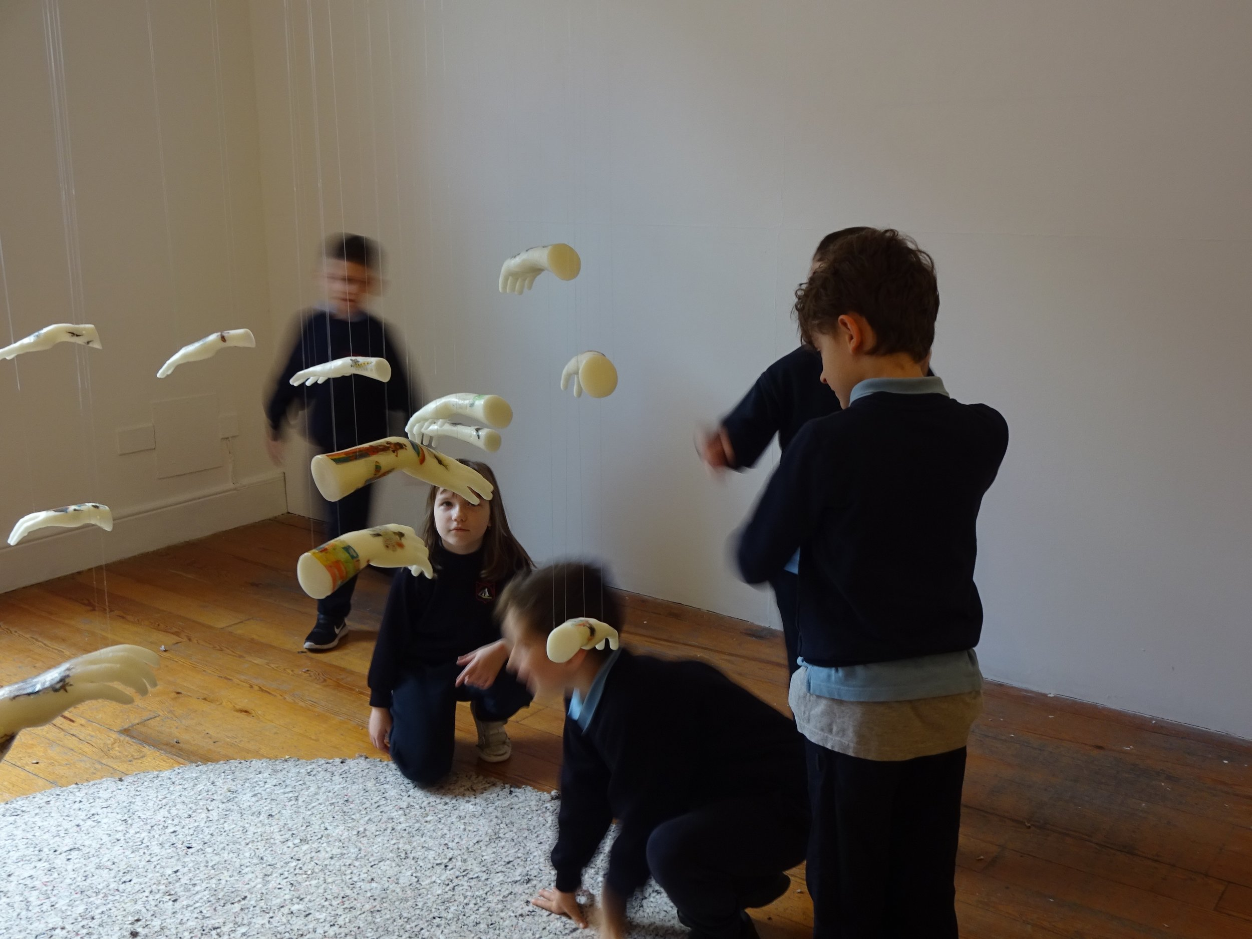 Students were given time to look at the artwork in the gallery, looking in silence for better concentration. Later questions included 'How did wax turn into hands?', 'Why do they have no thumbs'?'