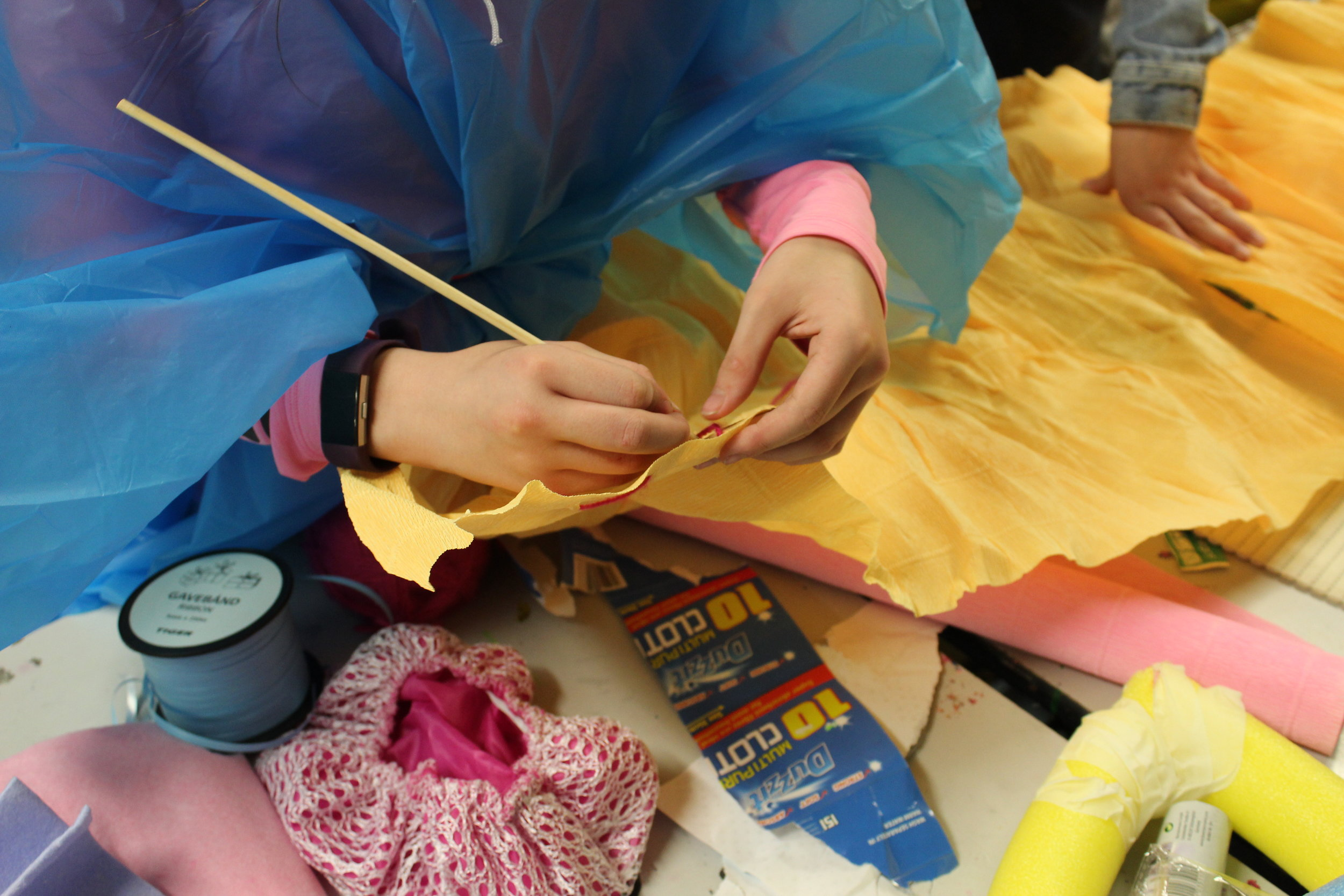 Using a skewer to weave fabrics together