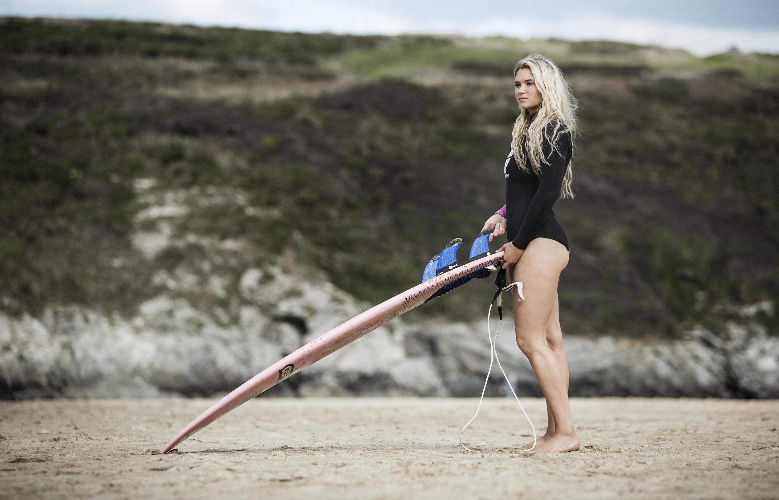 Lucie with surfboard