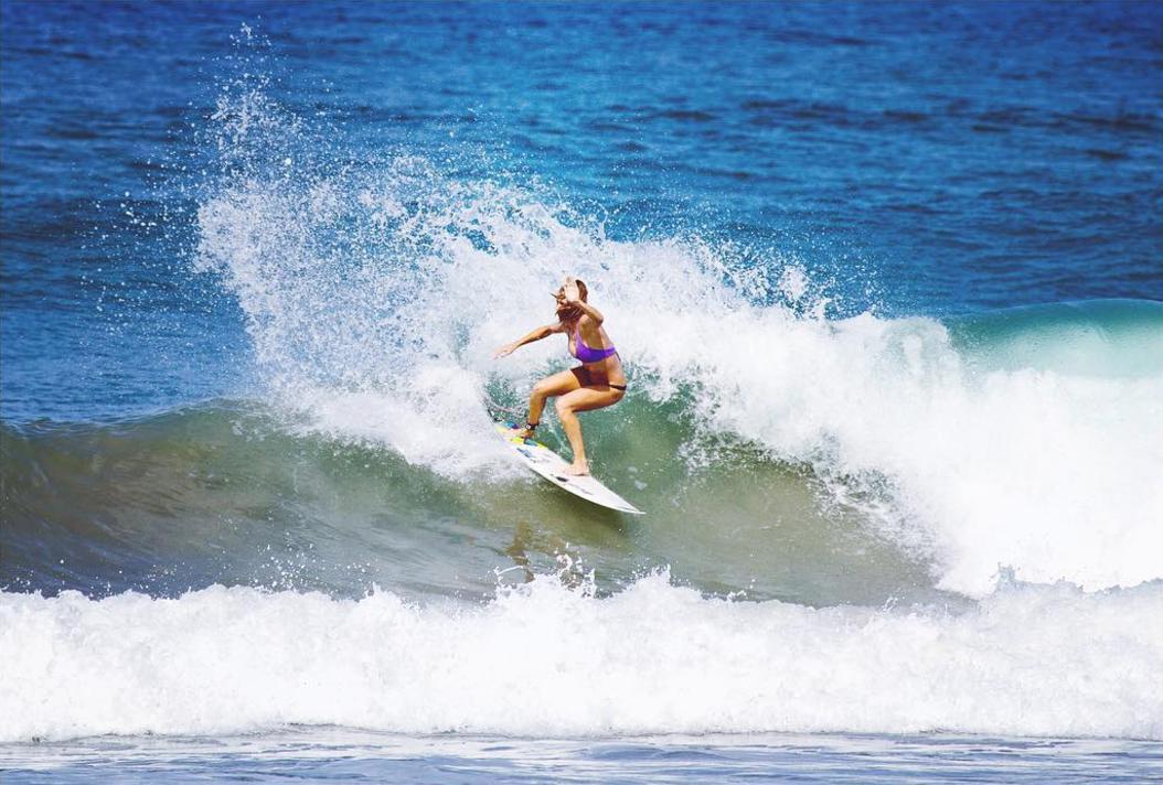 Evie Johnstone surfing