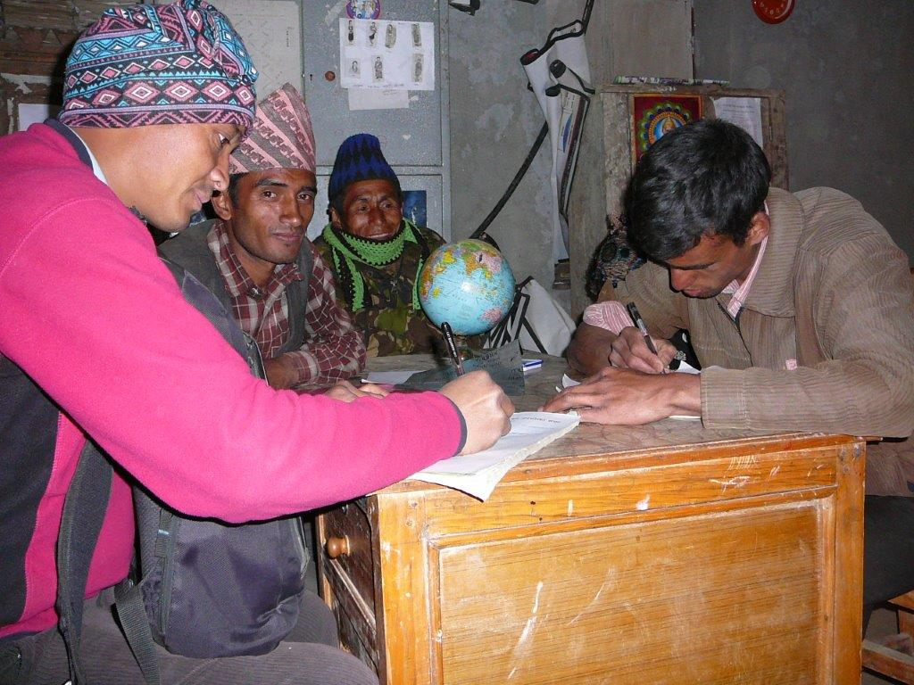 Signing maintinace contract with  the villagers for timily maintinance.jpg