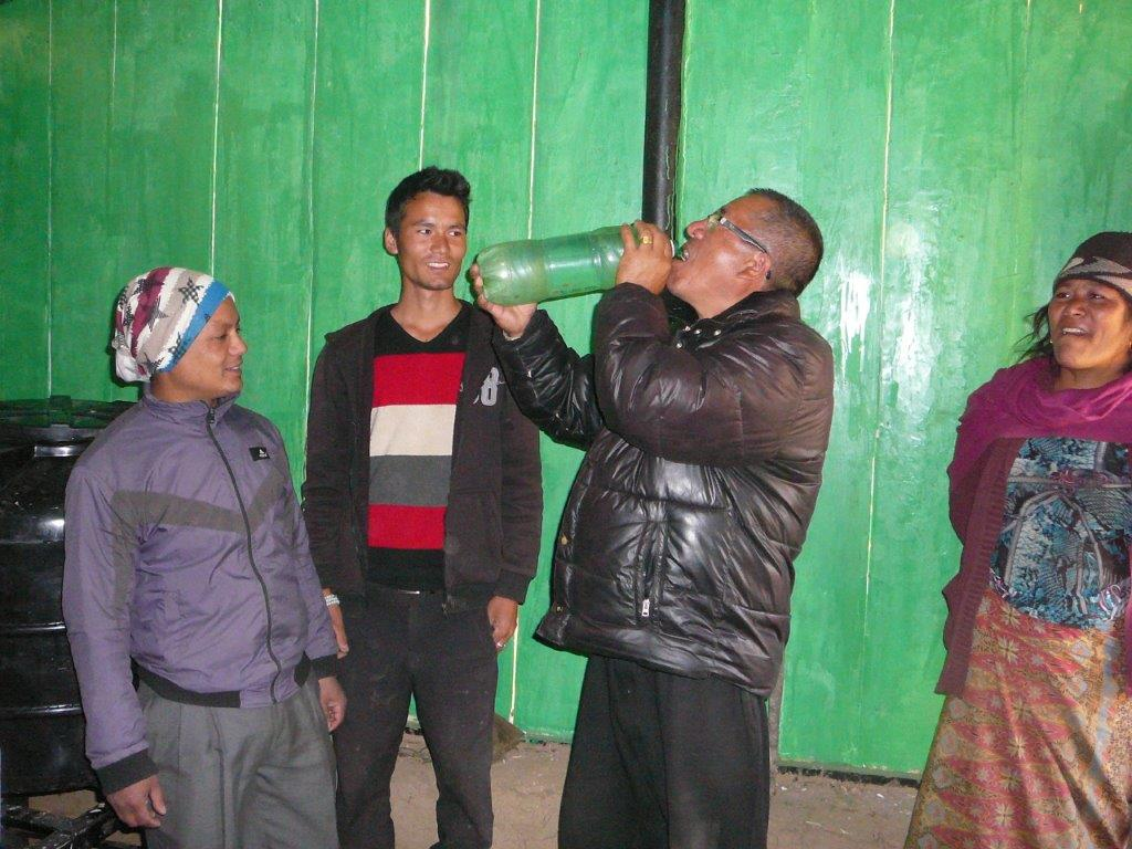 Water testing by villagers.jpg