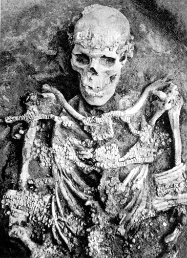 The skeleton of a managed 60covered by mammoth ivory beads, found at at Sungir, an archaeological site dating to 26,000 - 28,000 BCE,near present-day Moscow, Russia,