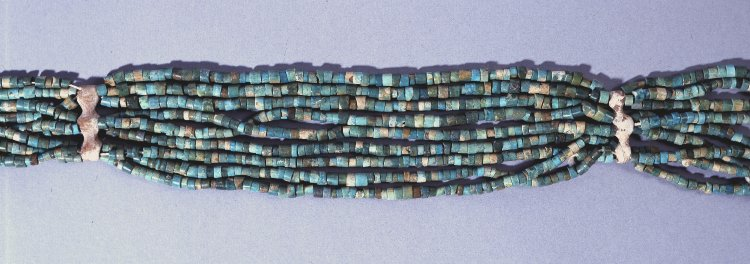 Beaded girdle found over the knees of the male corpse in Grave 592 at Mostagedda in Egypt, ca. 4000 BCE. While the small beads are glazed steatite, the spacers are bone.  The girdle is preserved at the British Museum as Cat. No. EA62150. Image courtesy Trustees of the British Museum.