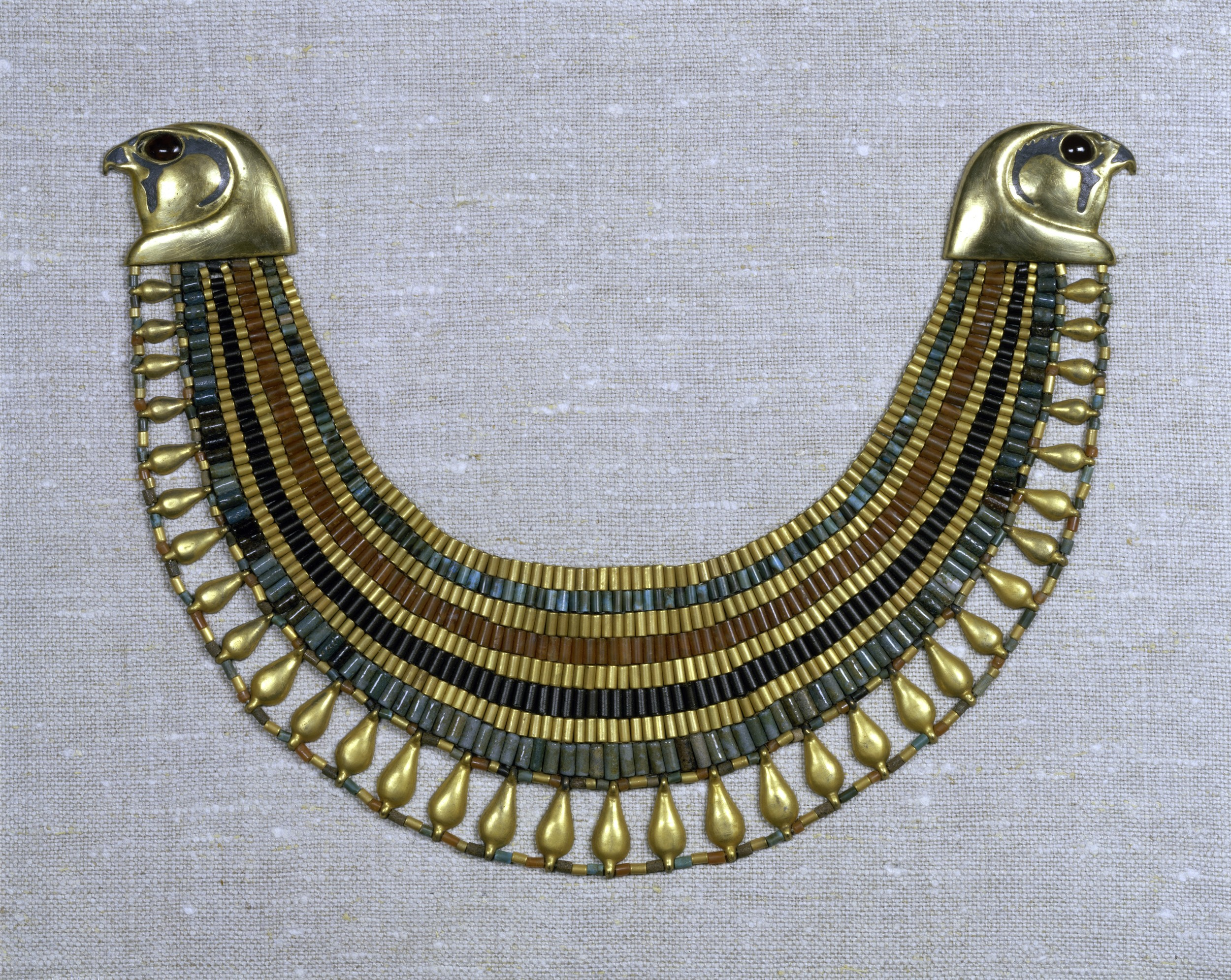 The beaded broad collar of Senebtisi (ca. 1850-1775 BCE), made to fit the nape of the neck thanks to 2-dimensional contouring of the sort already present in Egypt by ca. 2500 BCE. Made of gold, carnelian, turquoise and faience, the collar is preserved at the Metropolitan Museum of New York as Accession No.  08.200.30. Image courtesy Metropolitan Museum of Art, New York.