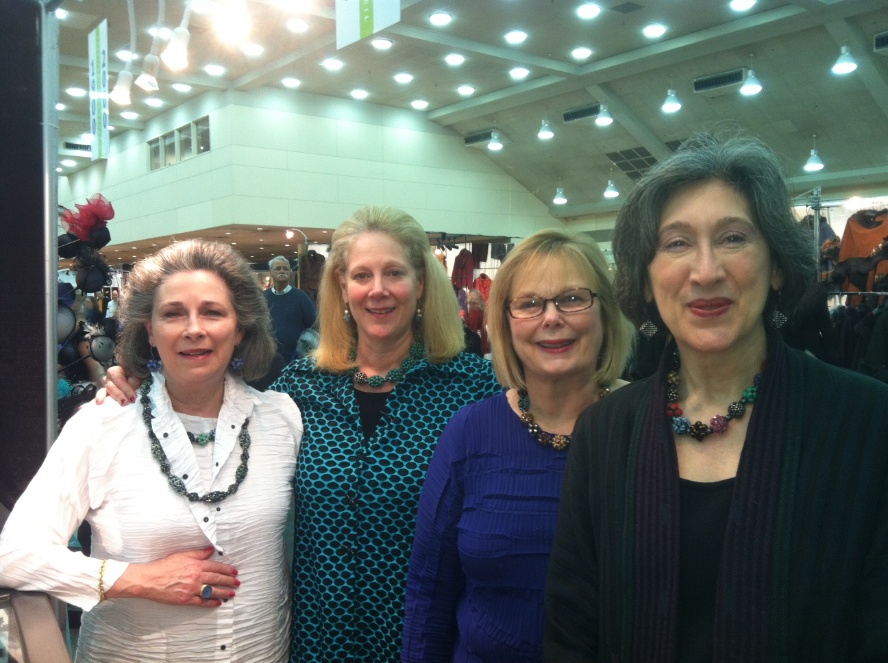 "Left to right: Tina Houston, Nancy Smith, Sharon Fawcett, Miriam Nisbet, American Craft Show, Baltimore, MD, Feb., 2014.    The Ladies Say:    ""We are four friends who have been coming to Valerie for many years. What we love about her is how distinctive her work is.  So many people we encounter when wearing her pieces recognize her work and appreciate her artistry. Other artists have told us how Valerie has shared her knowledge and helped them start their careers.  Most of all we love the beauty and versatility of her work.  Valerie's pieces make us happy when we wear them.  We wear her pieces with everything. We delight in responding to the complements we receive on our jewelry by naming her as the artist who made the piece.   Thank you Valerie for creating such lovely jewelry."""