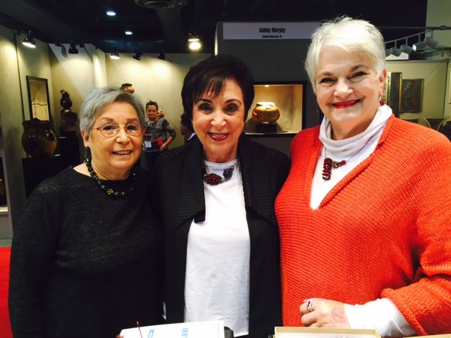 "From left to right: Ruth G., Shelly M., and Judy Y., three lovely ladies from the Philadelphia area who have been encouraging me and supporting my work for many years, photographed at the Philadelphia Museum of Art Craft Show, Nov., 2015.      Ruth says: "" I have been enjoying Valerie Hector's jewelry for more years than I can remember. Each year I look forward to seeing her again and selecting additional pieces to add to my large collection. Purchasing her beautiful individual beads and coordinating them with what I am wearing gives me much pleasure. I continually receive compliments which proves her gift of designing the beads attests to her creativity. Her pieces are my go to jewelry. Anyone purchasing Valerie's jewelry will not be disappointed.     Shelly says:  ""I have been  a collector of Valerie Hector for many years.  I love and enjoy each piece that I have acquired.  Each time I wear her jewelry, which is almost everyday,  I get many, many compliments. It is my pleasure knowing Valerie.  Valerie's work is absolutely superb!!!   Judy says:  ""If I had the money I would by one of everything. I have been collecting Valerie for many years. Just about every day I have one of her pieces on and get compliments all the time."""