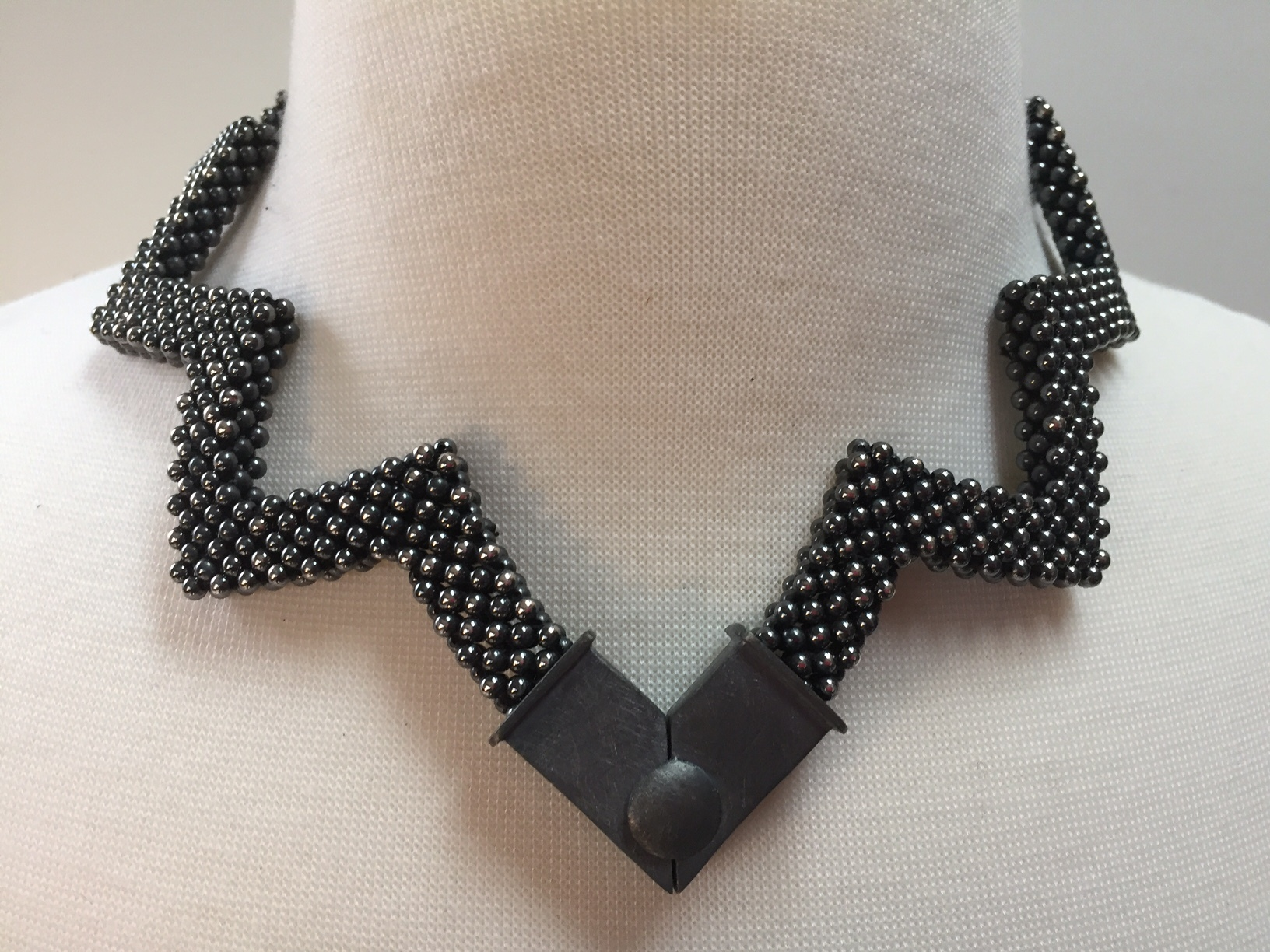 """Reversible Sterling Silver """"Lotus"""" Necklace with the clasp worn in front. This is the brighter side of the necklace."""