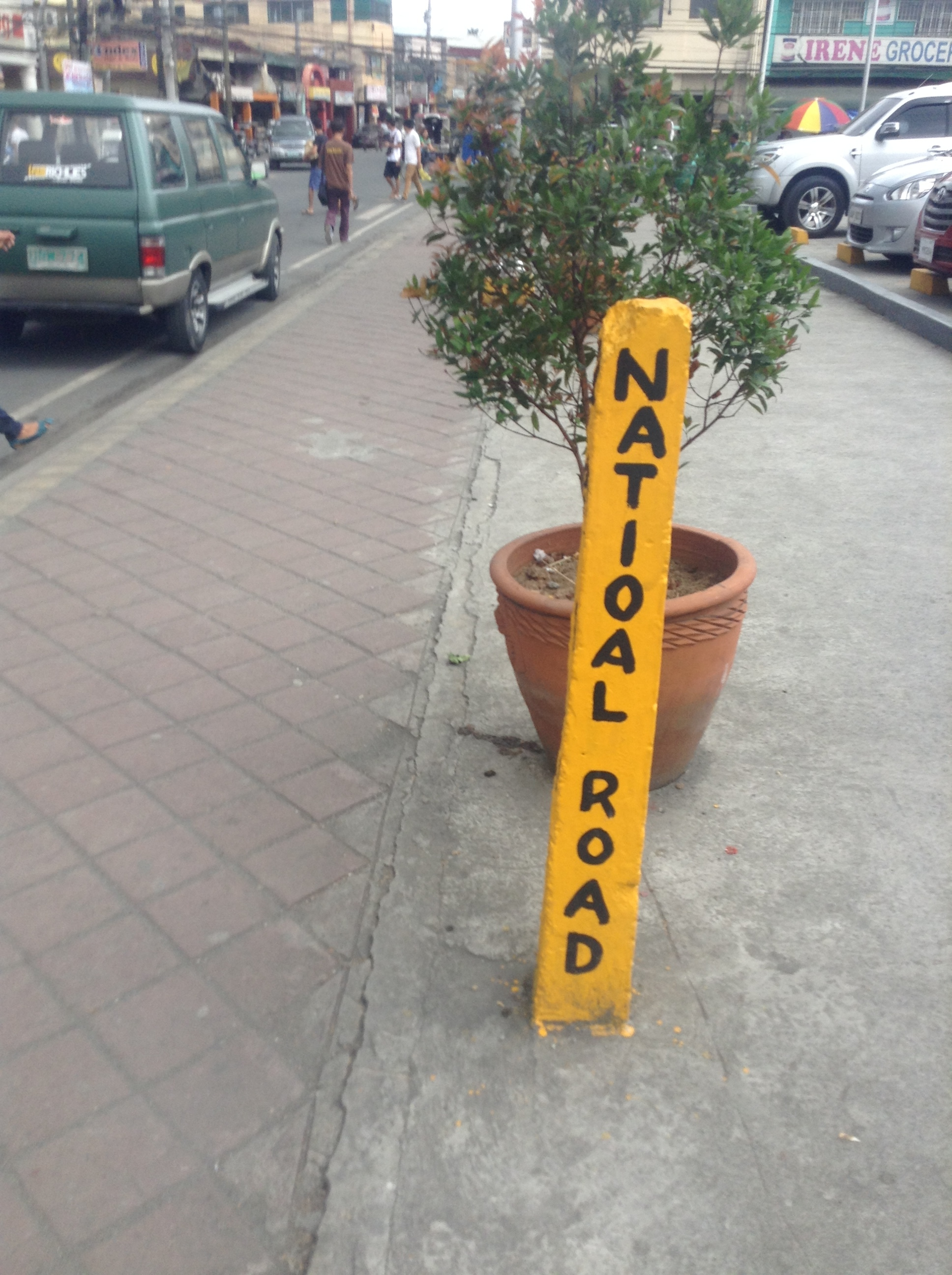 You don't have to walk far for the road signs to start getting exotic. (Outside the Jollibee,Cavite City)