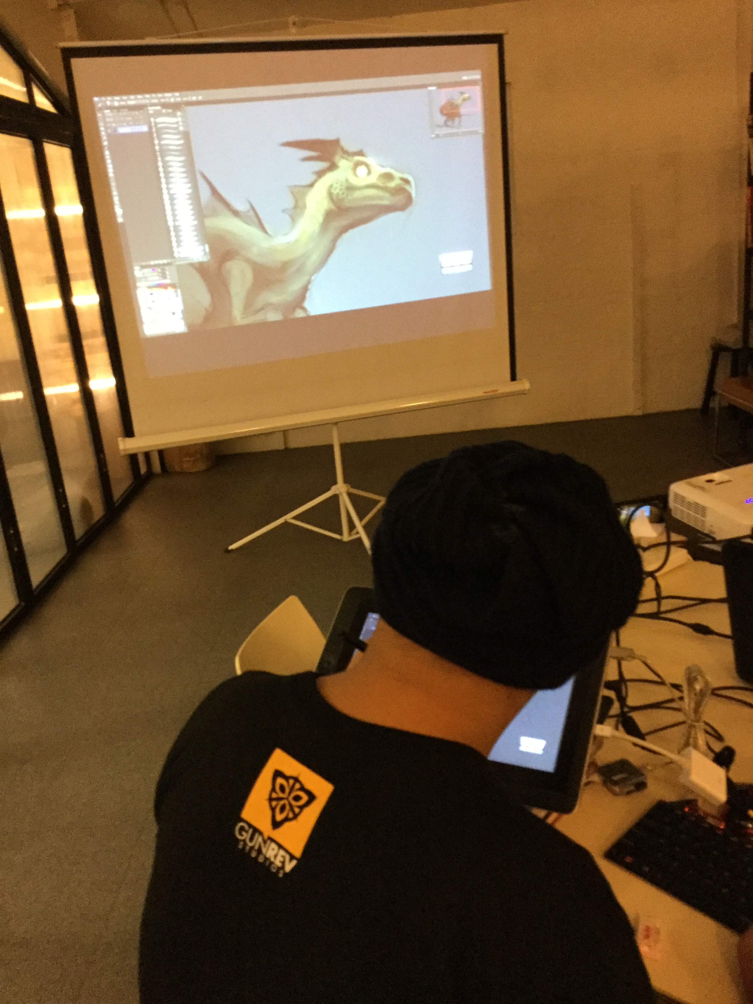 Senior Art Director Brian Valeza brings dragons to life live.