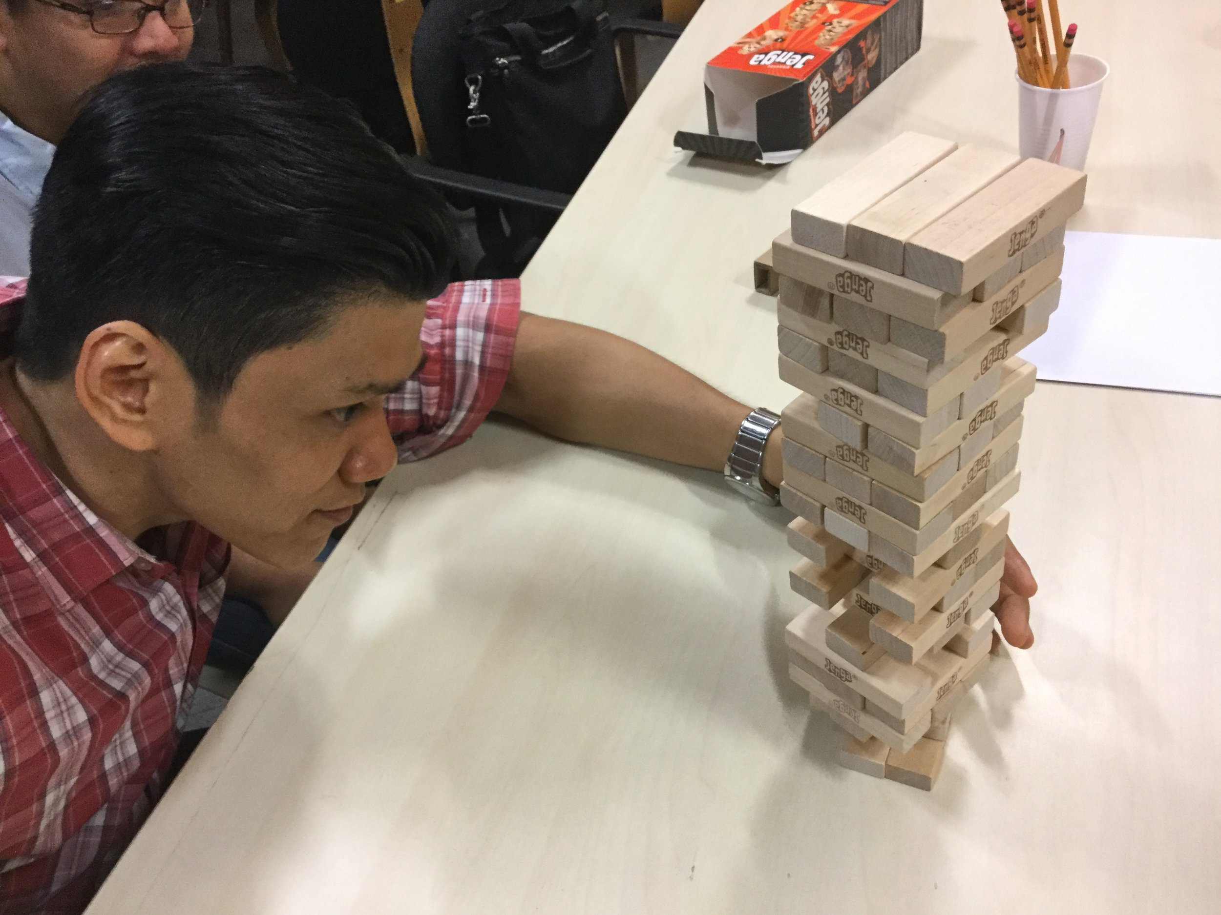 Managing Director Emmanuel Javier steadies his hand against the tower.