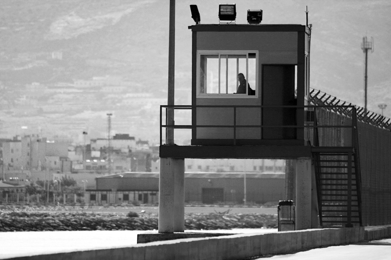 A guard tower in the border fence of Spanish enclave Melilla. Many migrants (mostly those from various African countries), attempt to swim over 8 hours in the sea to make it around this deadly border and onto European soil in hopes of getting Spanish papers.