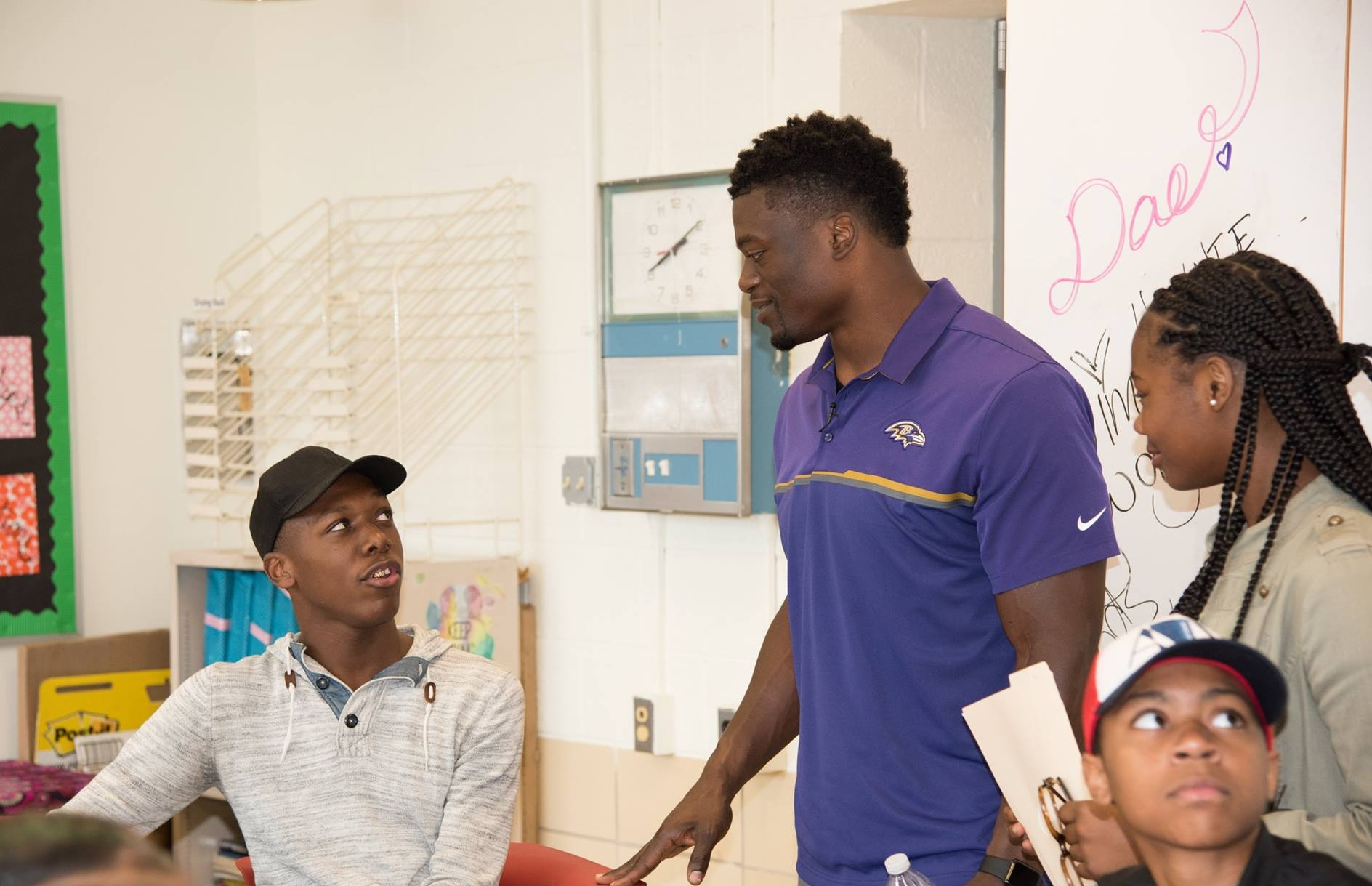 Renaissance Academy Senior Tyshaun Wallace speaks to Ravens tight end Benjamin Watson after the press conference on Monday, September 18, 2017.