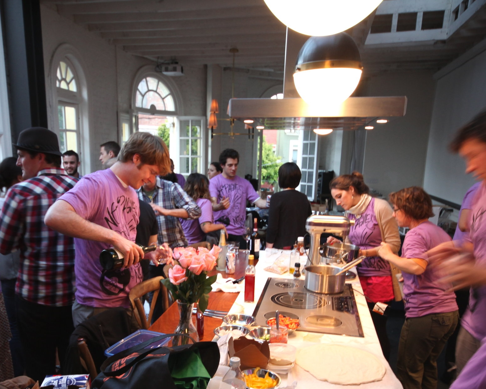Sierra Fish-244-lots of ppl wearing purple around kitchen.JPG