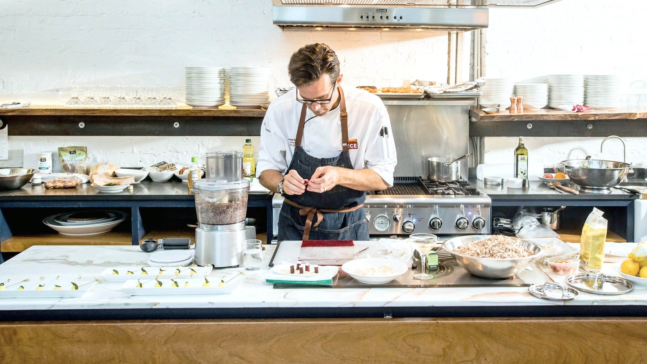 Photographer Hardy Wilson captured the beautiful natural light in the space during the preparations for a business dinner event with Chef James Briconie preparing a delicious dinner for 25 guests.