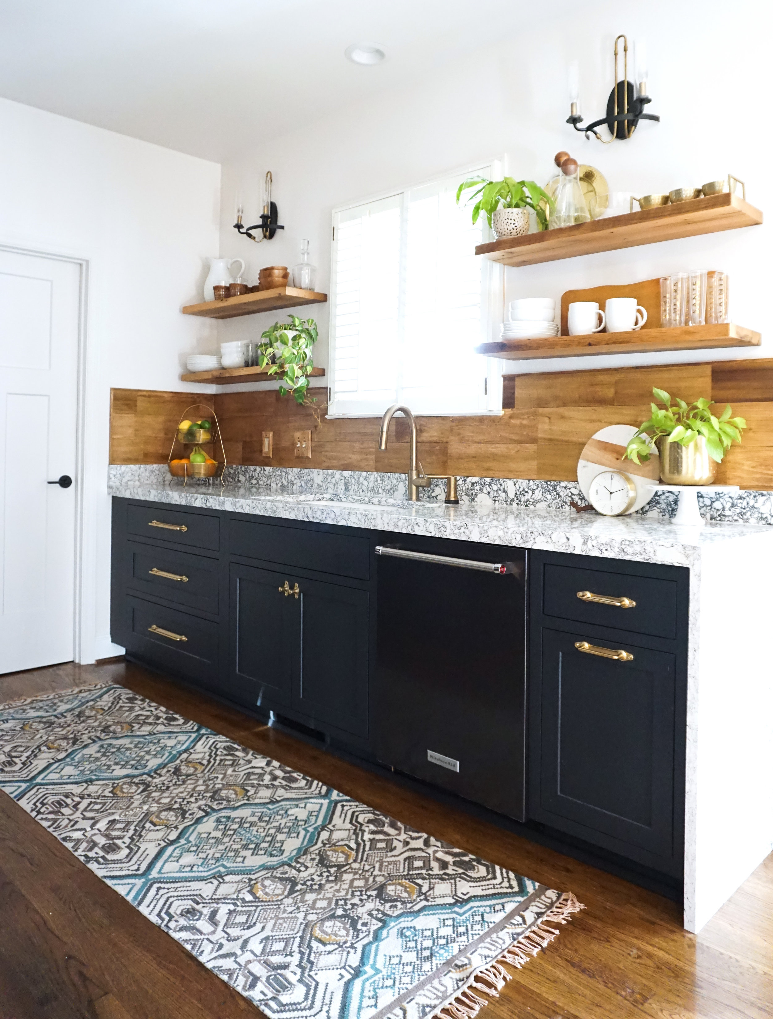 I opted for drawers in my lower cabinets whereever I could because they are so much easier to keep organized than door base cabinets. The drawers make for easy accessibility to pots, pans, cutting boards, etc. Pulls and knobs are from Rejuvenation.