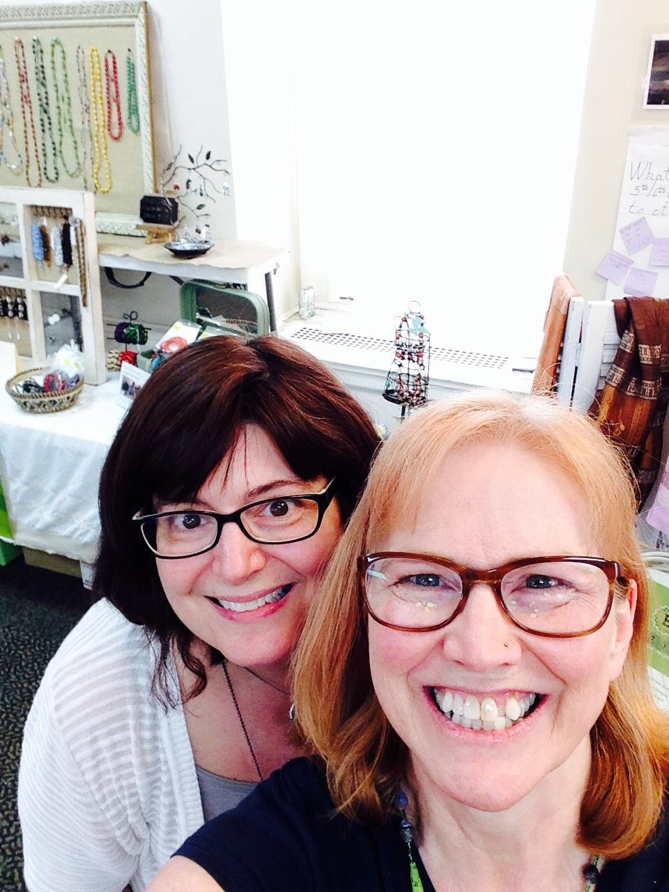 Julie and Deb selling Elevat products at a fair trade sale