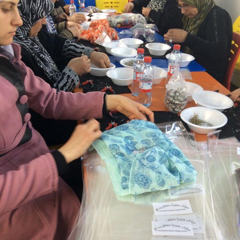 Syrians make scarves at a refugee camp in Jordan