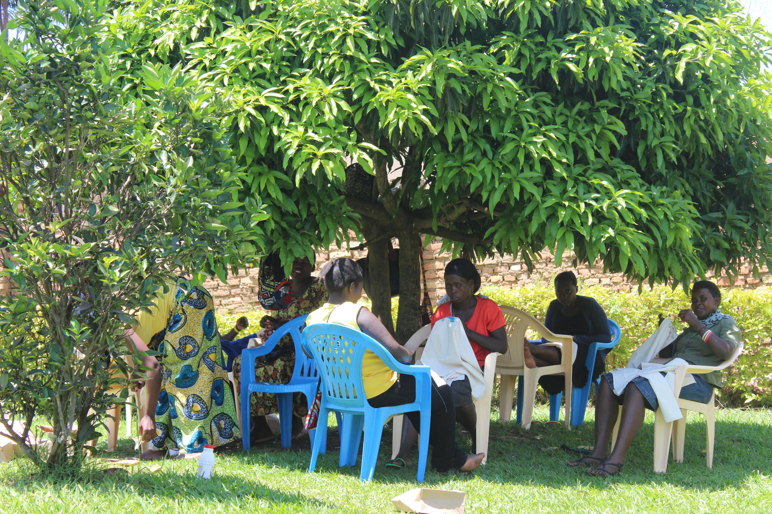Sewing under the mango tree