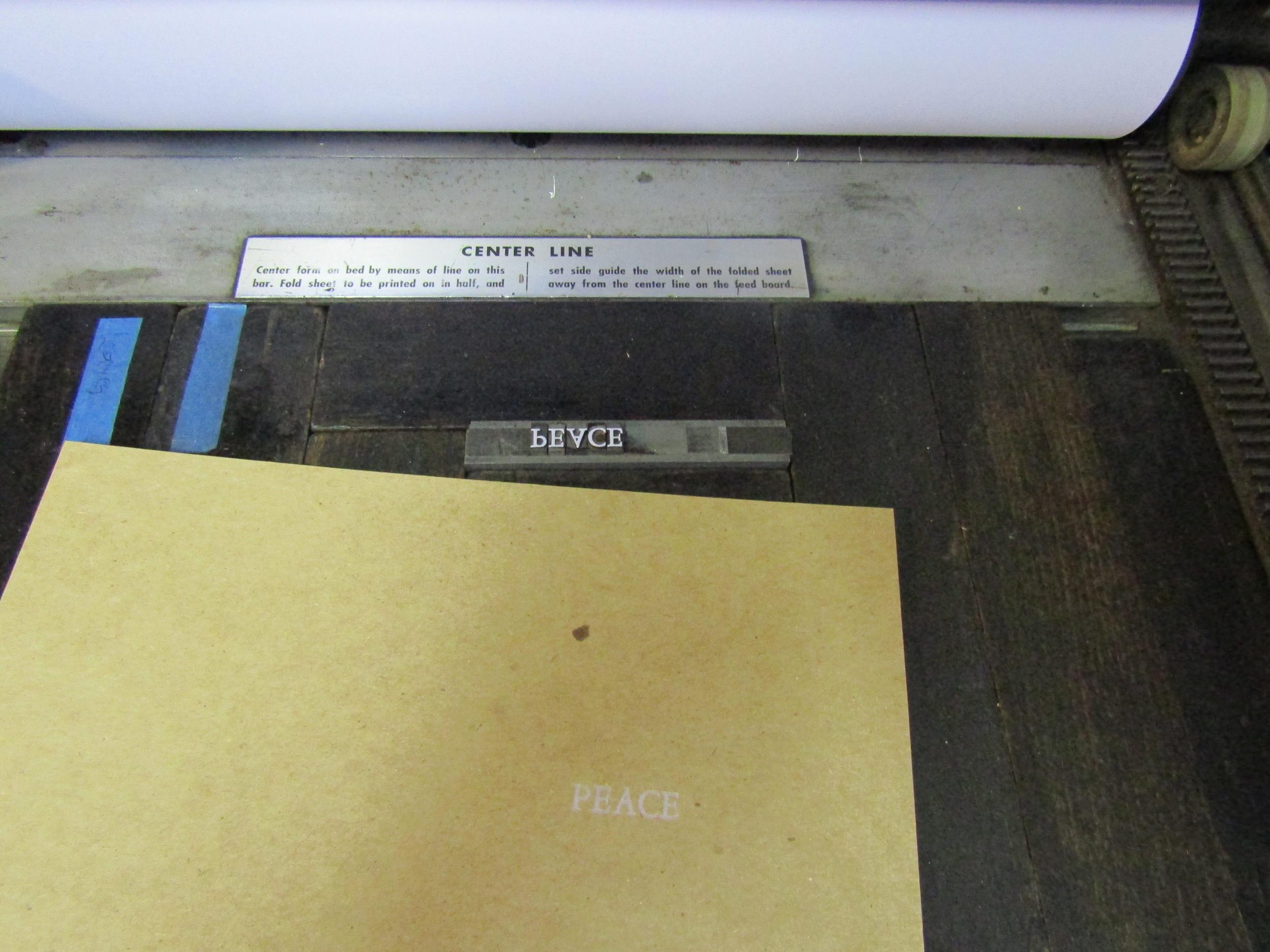 Printing interior text using metal type