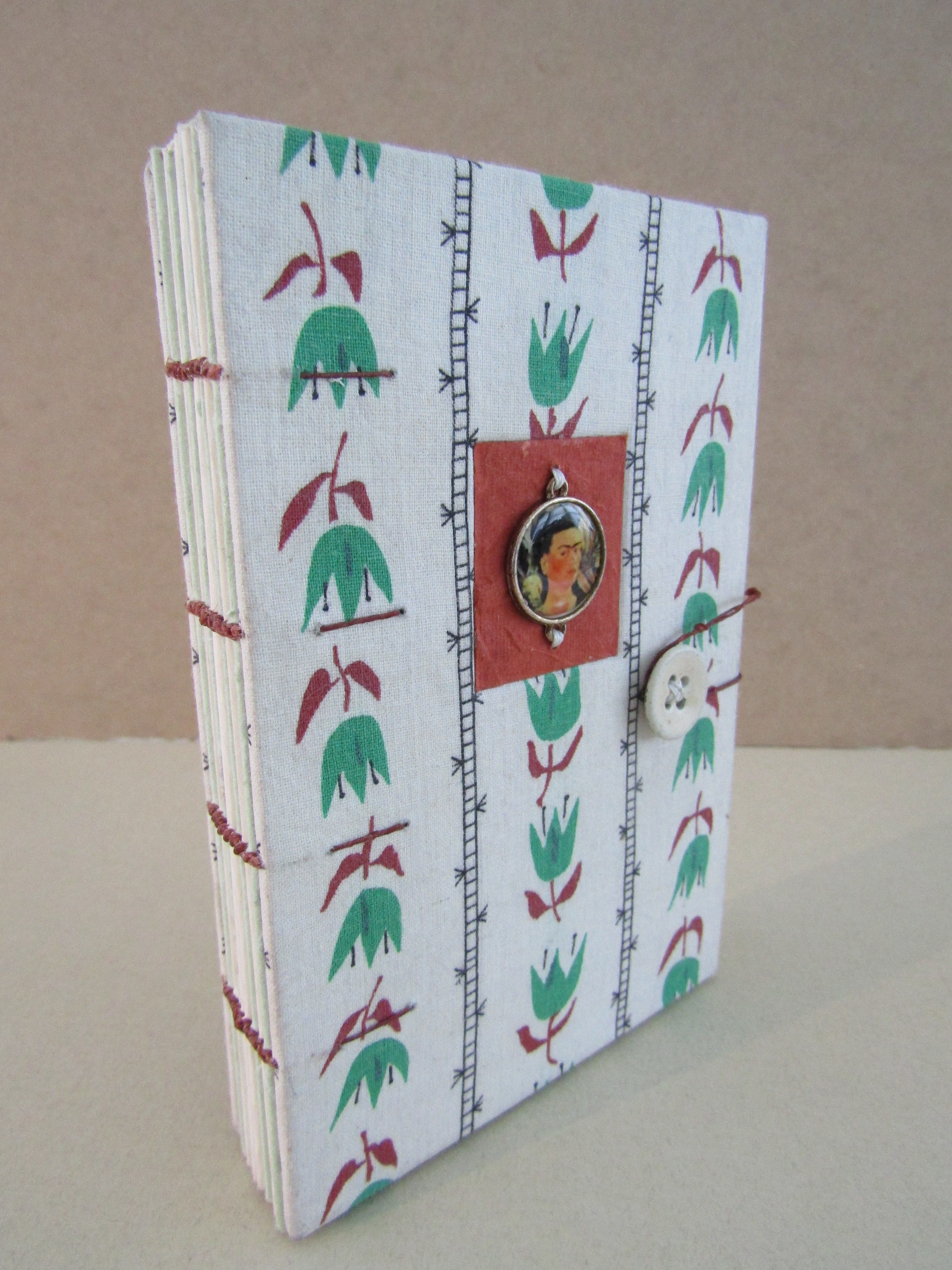 Four Needle Coptic Book With Backed Fabric and Sewn Embellishment on Covers