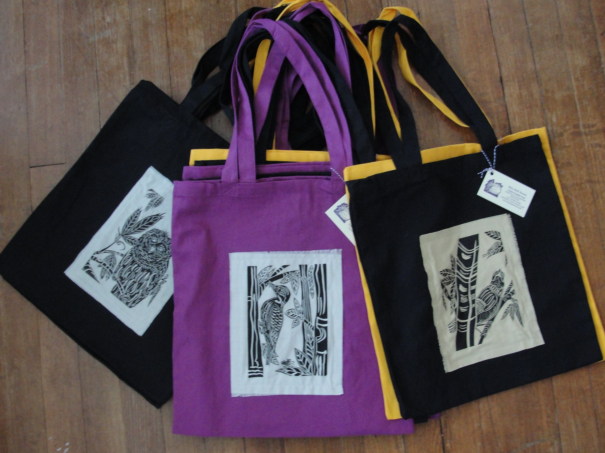 I printed several birds on cotton muslin. I then sewed them to cotton canvas bags....so much better than paper or plastic!