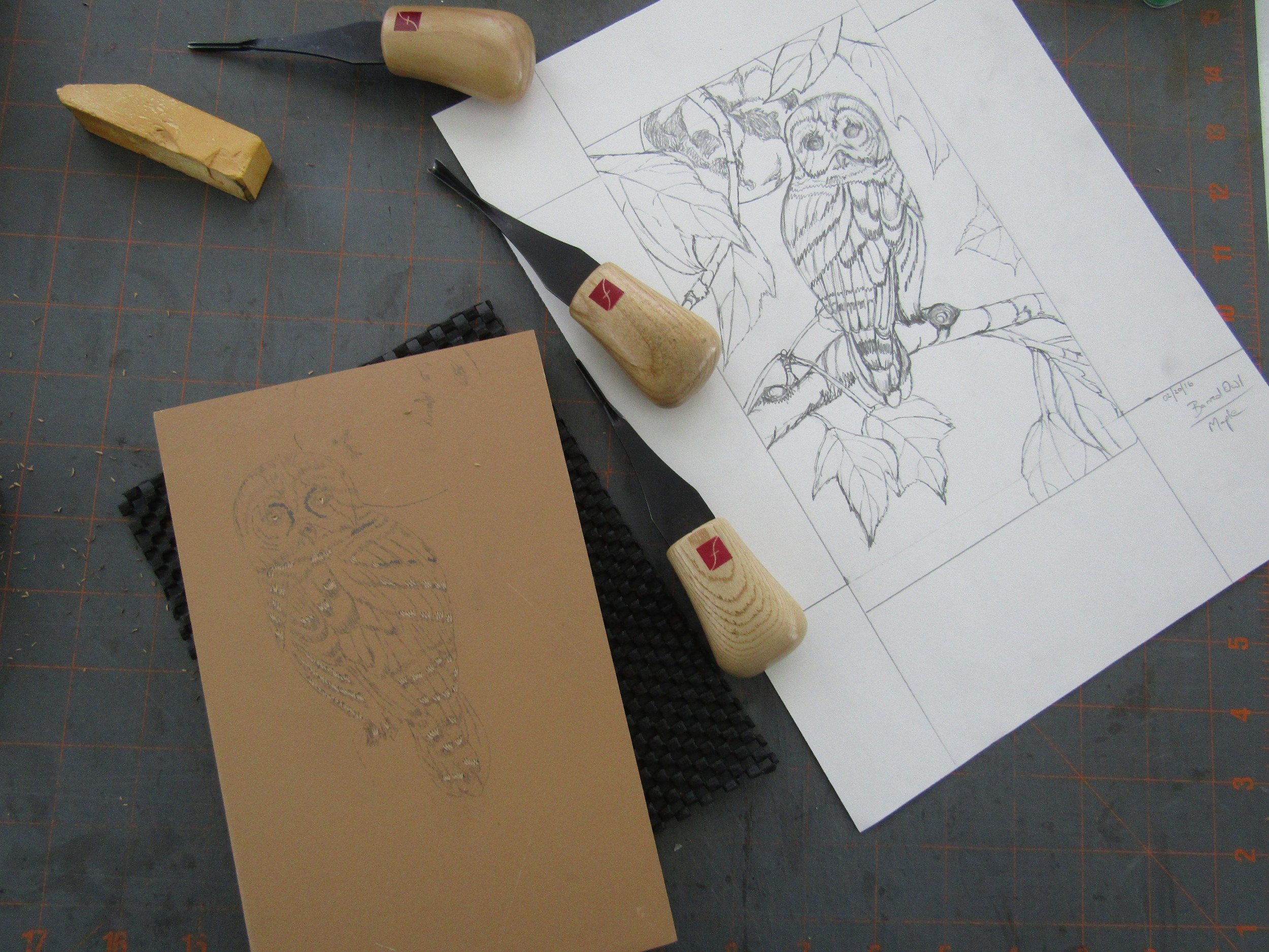 The beginning stages - I am carving out what will remain white on thie print.