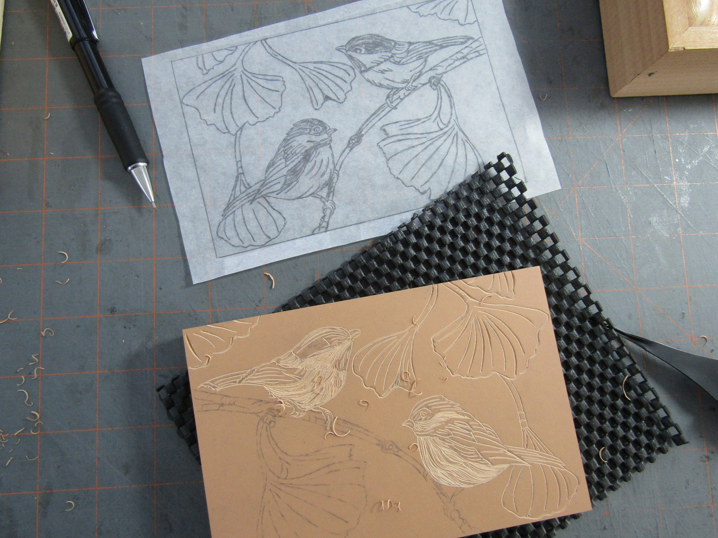 Carving a pair of chickadees perched in a Ginkgo tree.