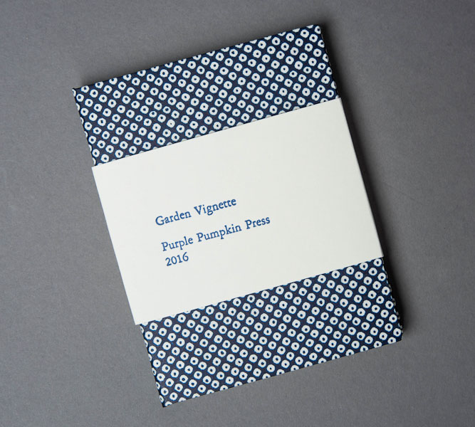 Cover with letterpress printed wrap.