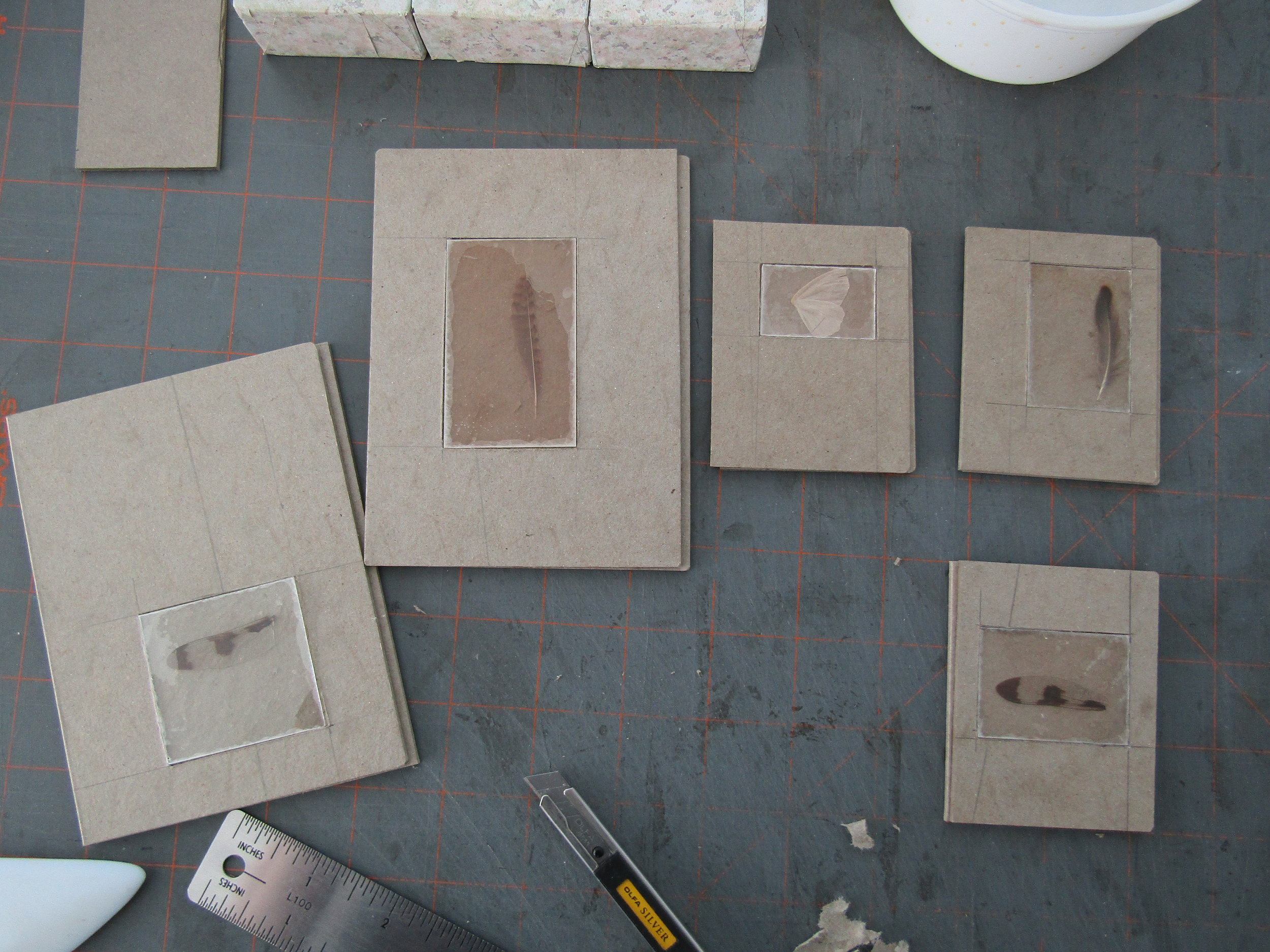 Carving recessed areas in the Davey board for windows.