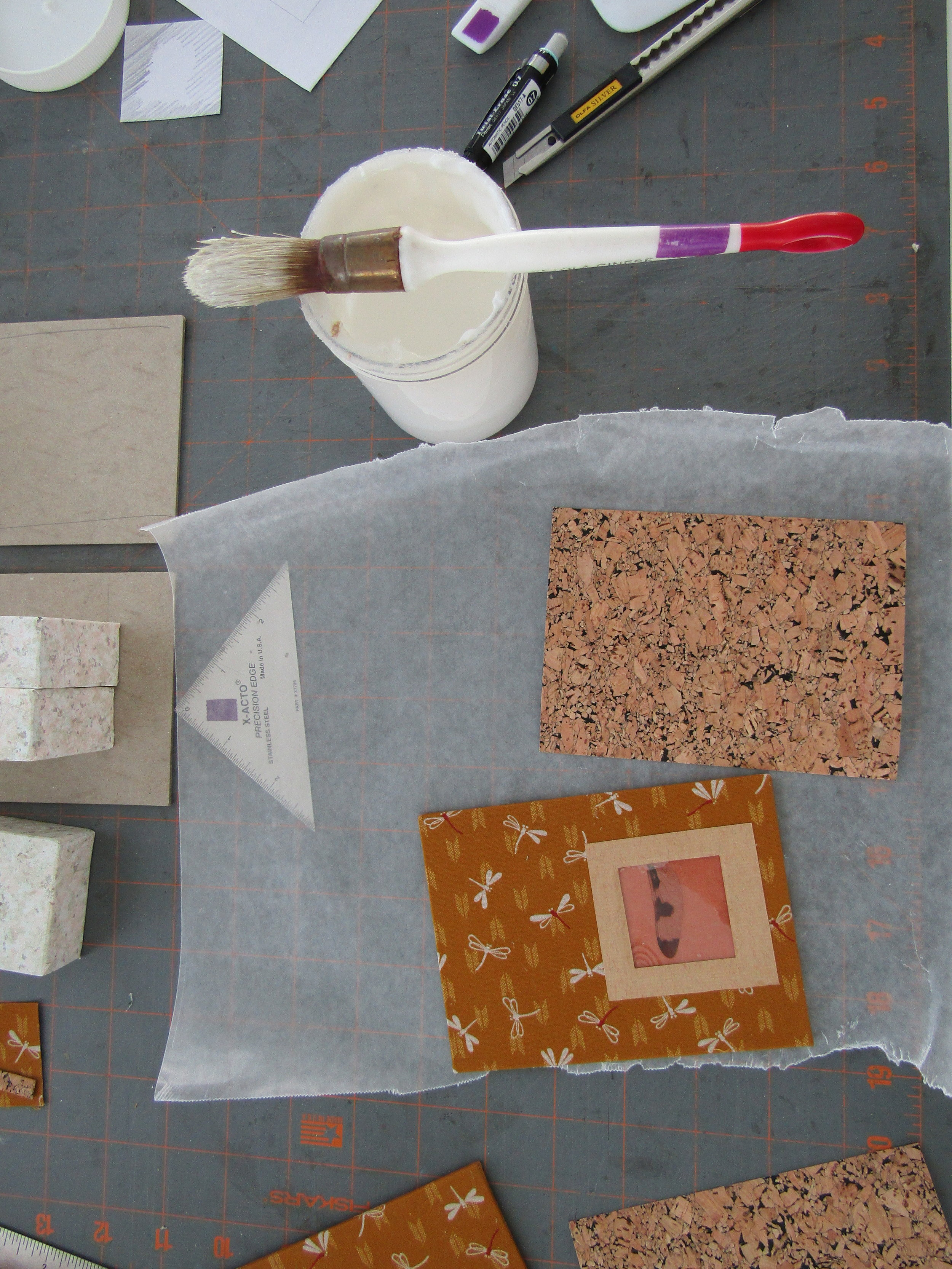 Covered book exterior using dragonfly fabric and ephemera; interior covered with cork paper.