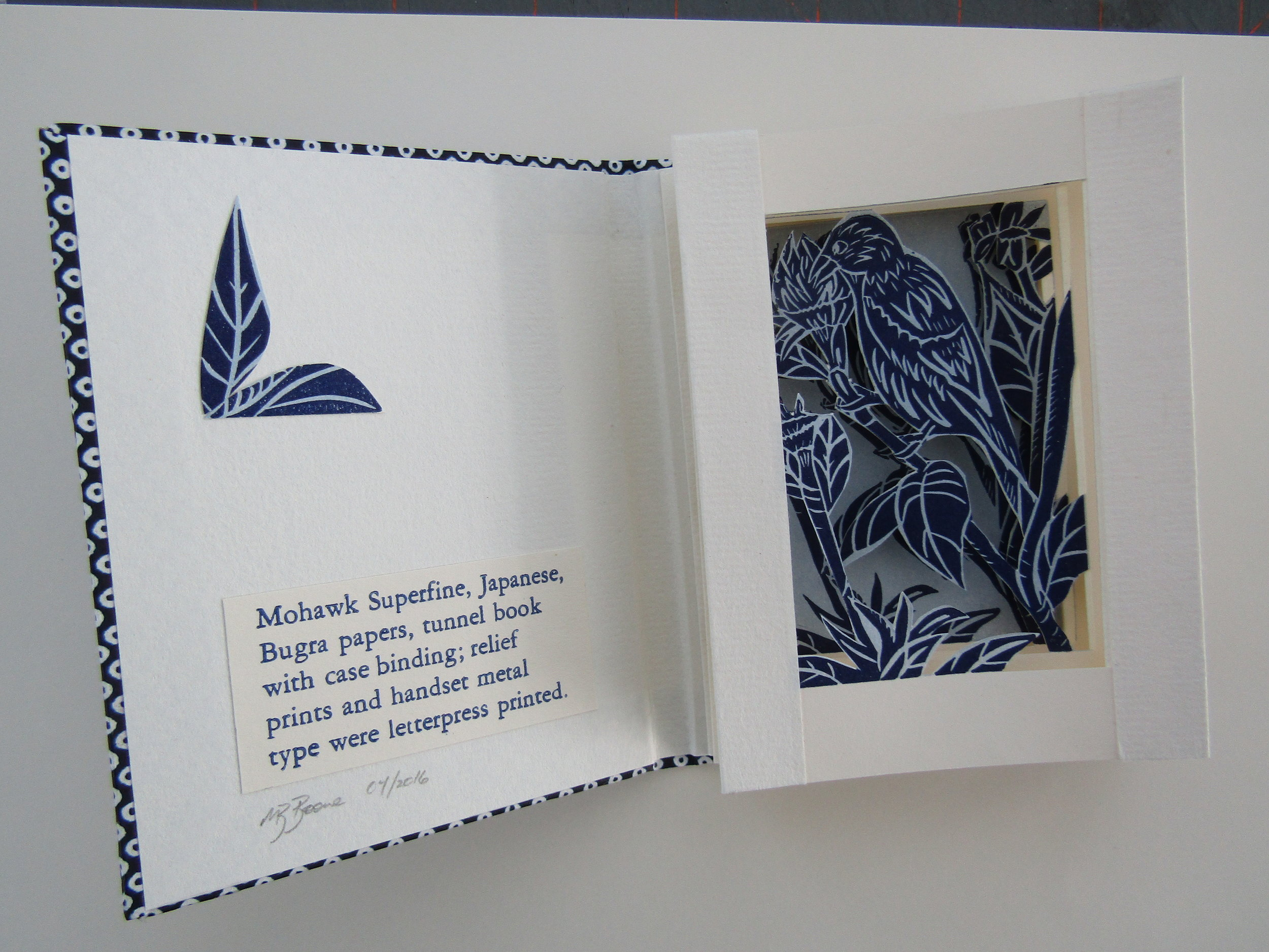 Colophon and a bit of collaged embellishment have been added to  Finch in the Garden ;now to assemble and add the wrap.